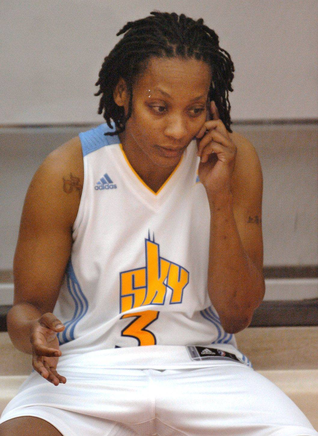 Sky veteran guard Dominique Canty on the phone during media day for Chicago Sky.