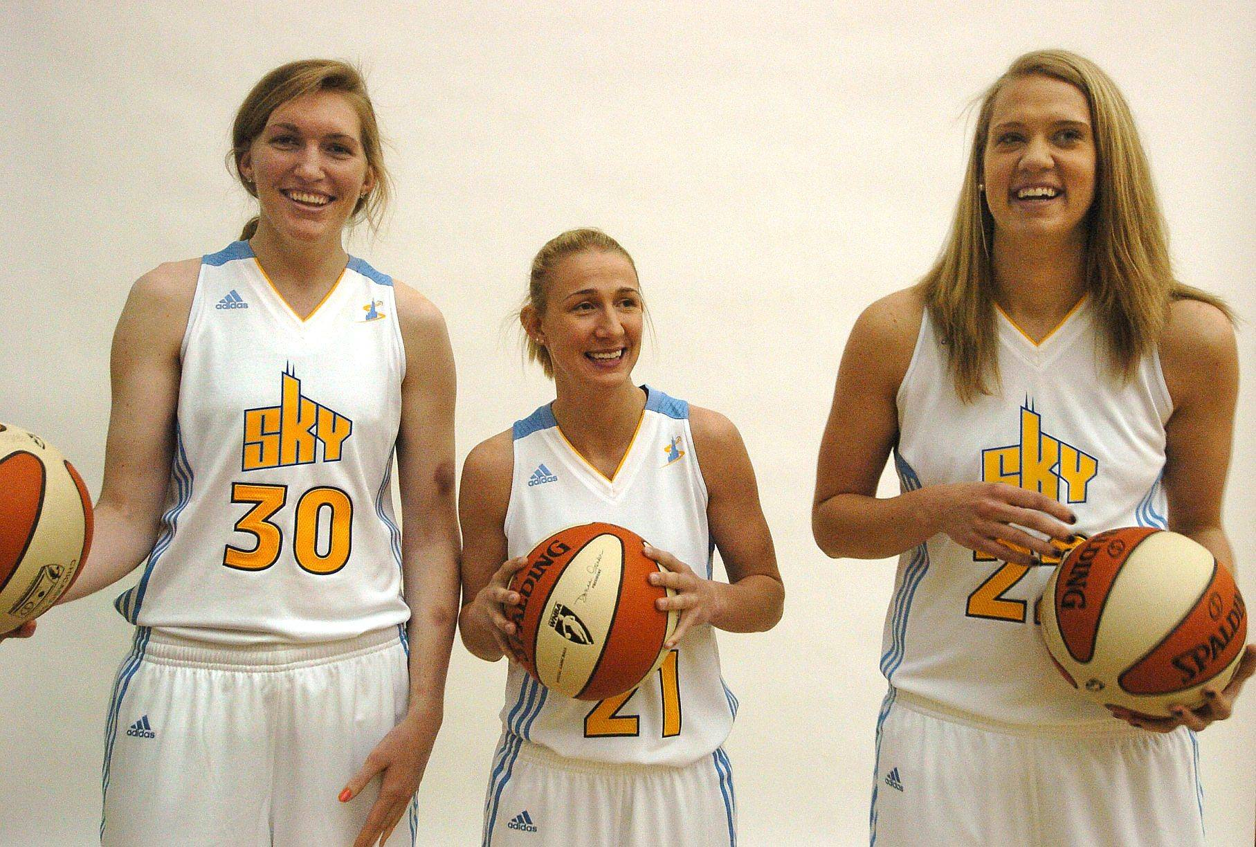 Three rookies from left, Carolyn Swords, Courtney Vandersloot and Amy Jaeschke pose for media day for Chicago Sky.