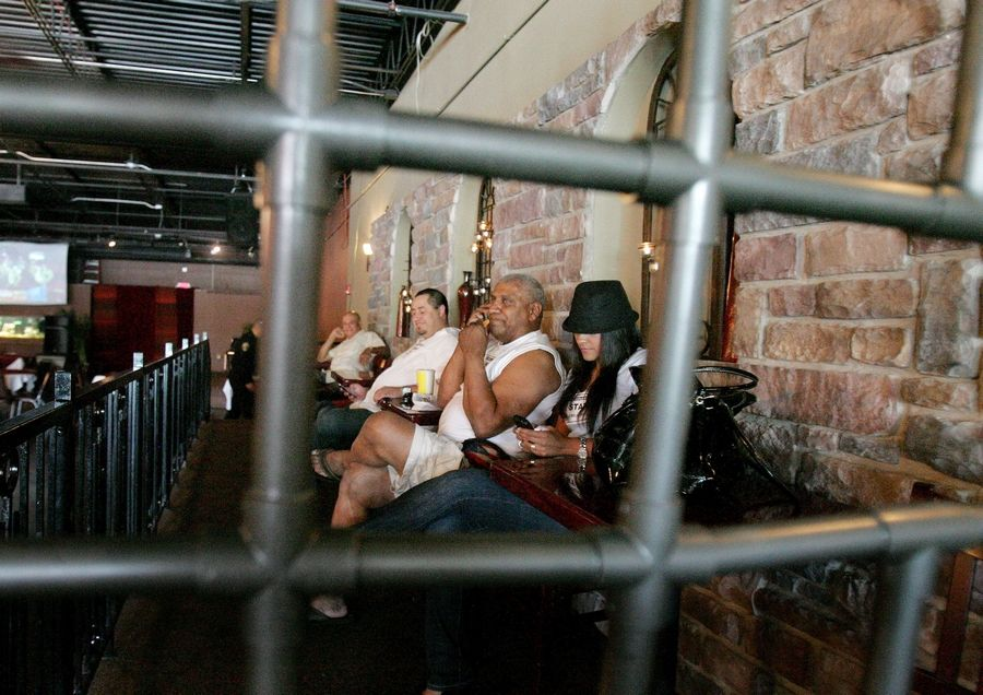 "People sit in ""jail"" for donations, part of the Aurora Puerto Rican Cultural Council's ""Lock-Up"" fundraiser for scholarships, which was held Sunday at Esteban's in Naperville."