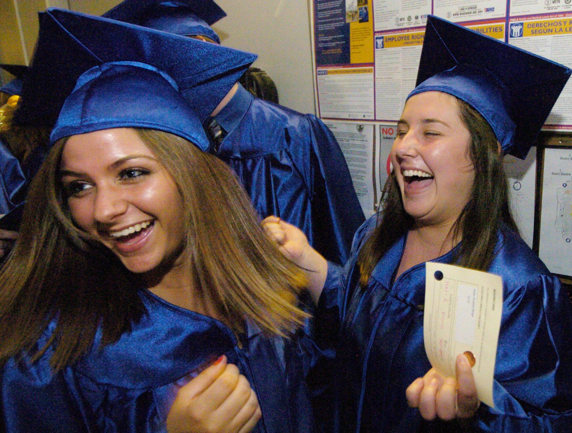 Juliane Nemec, left, and Hallie Nerge laugh together prior to the Dundee-Crown graduation at the Sears Centre in Hoffman Estates Saturday, May 21.