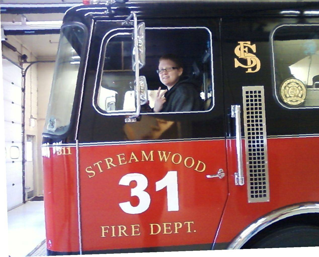 Feeling at home during her tour of a Streamwood fire station, Shelby Williams soon will be taking college classes to fulfill her dream of becoming a firefighter.
