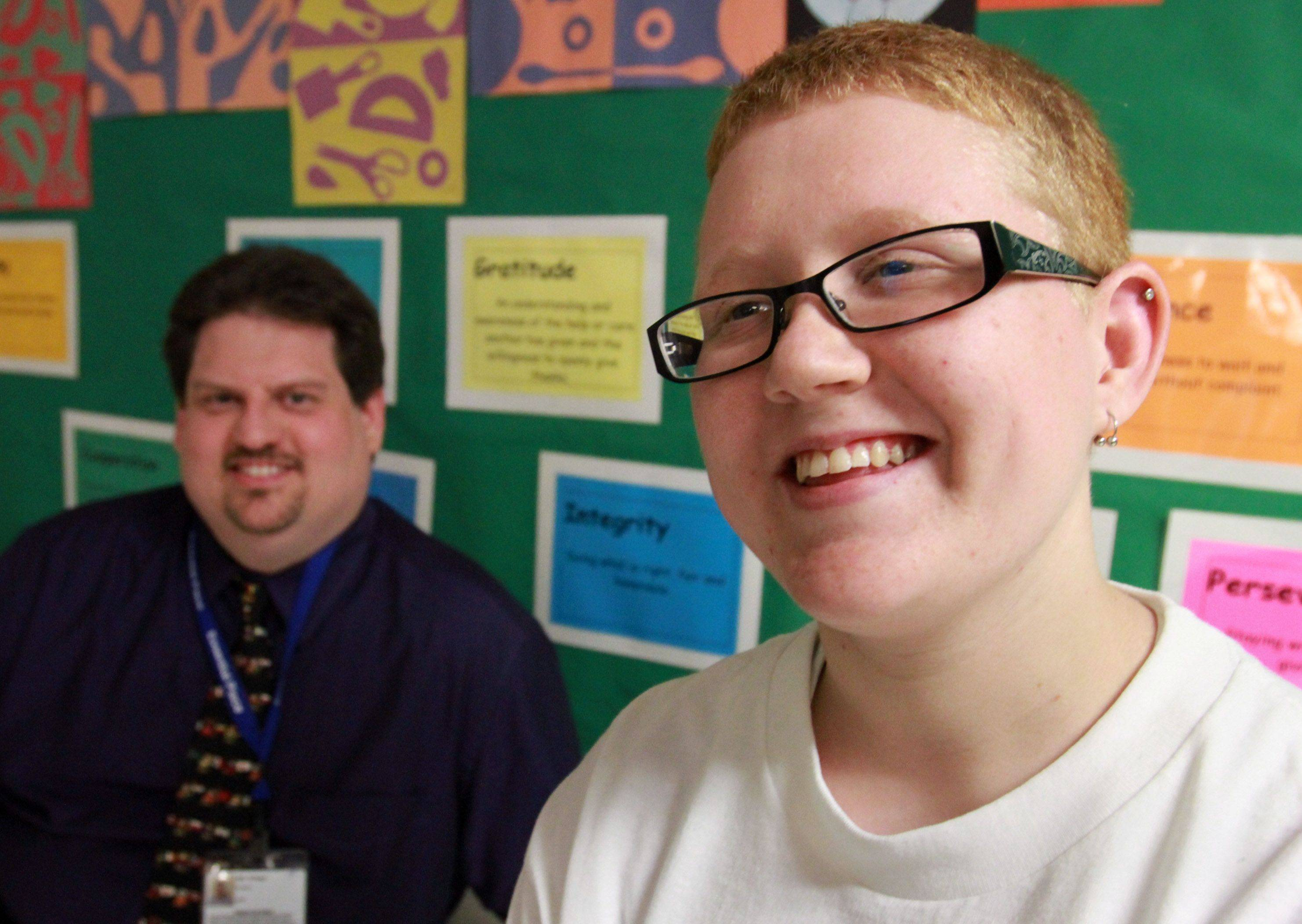 "George LeClaire/gleclaire@dailyherald.comLiving evidence of a ""best-case scenario,"" 19-year-old special-education student Shelby Williams puts a smile on the face of George Krieger, principal at Cornerstone Academy in Streamwood. Shelby has been accepted into college and will take classes to become a firefighter."