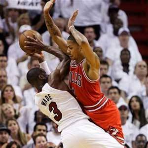 Derrick Rose collides with Miami's Dwyane Wade during the second half.