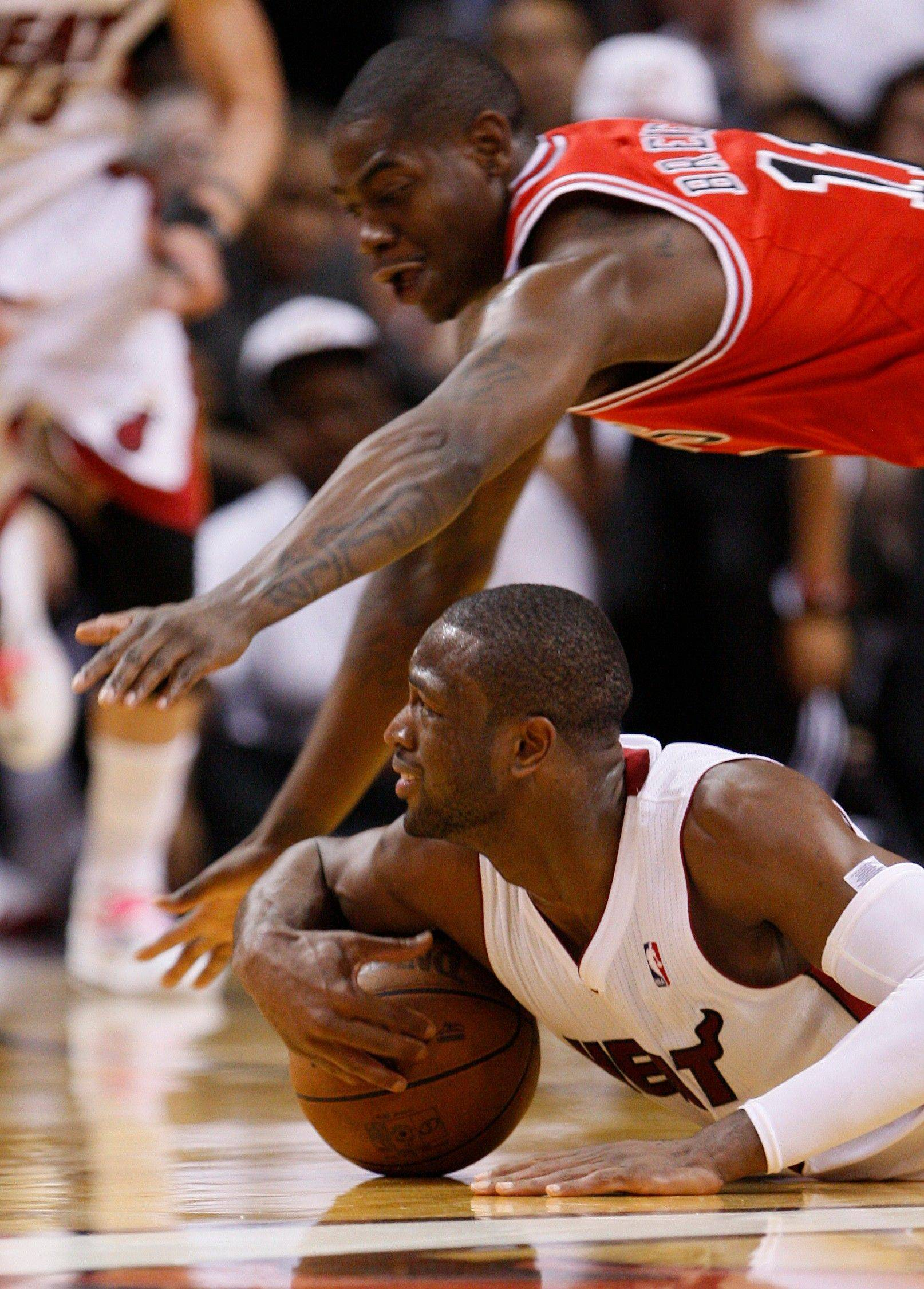Miami Heat's Dwyane Wade, below, battles for a loose ball with Chicago Bulls' Ronnie Brewer during the second half of Game 3 of the NBA Eastern Conference finals basketball series in Miami, Sunday, May 22, 2011.