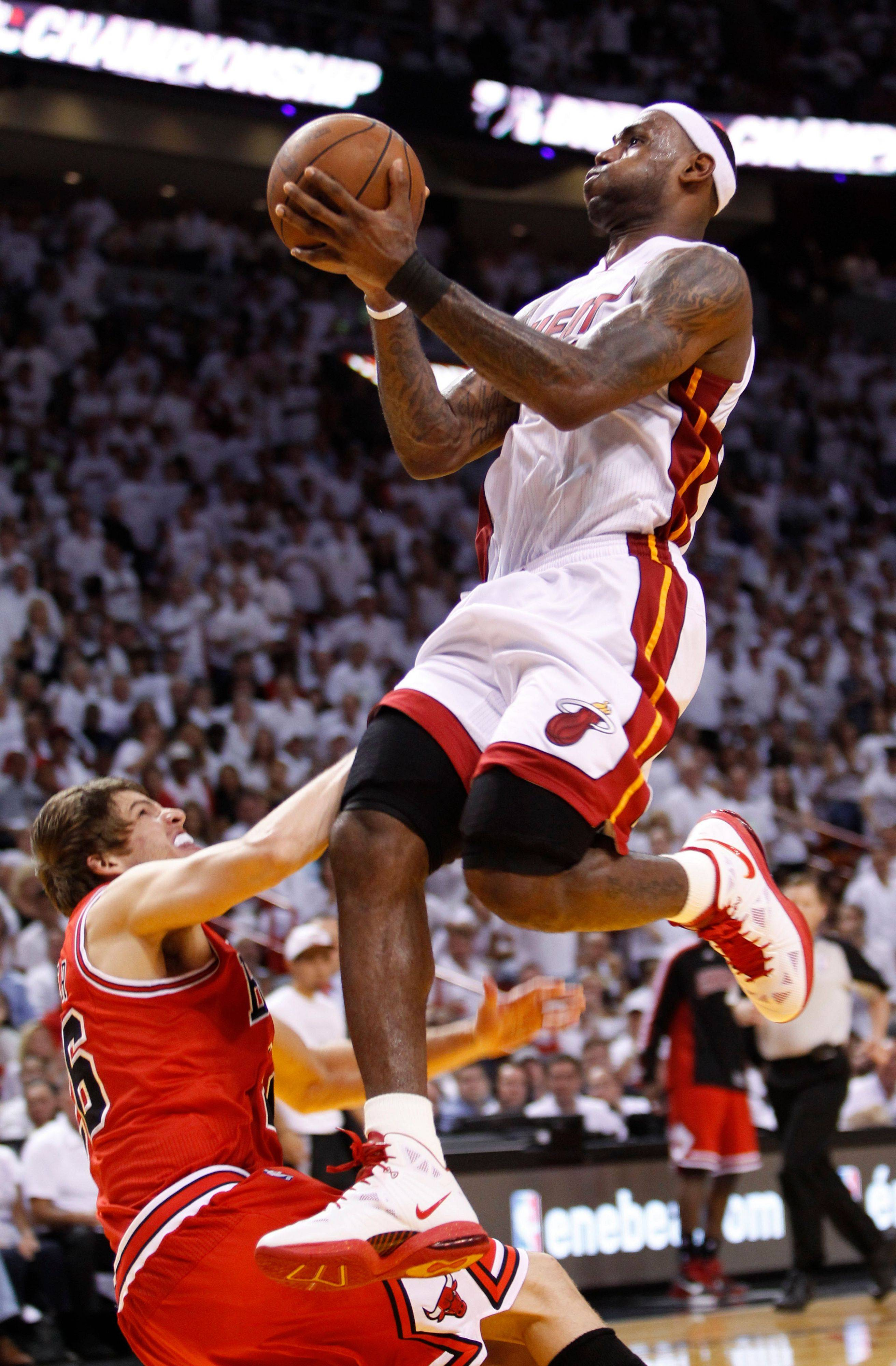 Miami Heat's LeBron James shoots over Chicago Bulls' Kyle Korver during the second half of Game 3 of the NBA Eastern Conference finals basketball series in Miami, Sunday, May 22, 2011. The Heat defeated the Bulls 96-85.