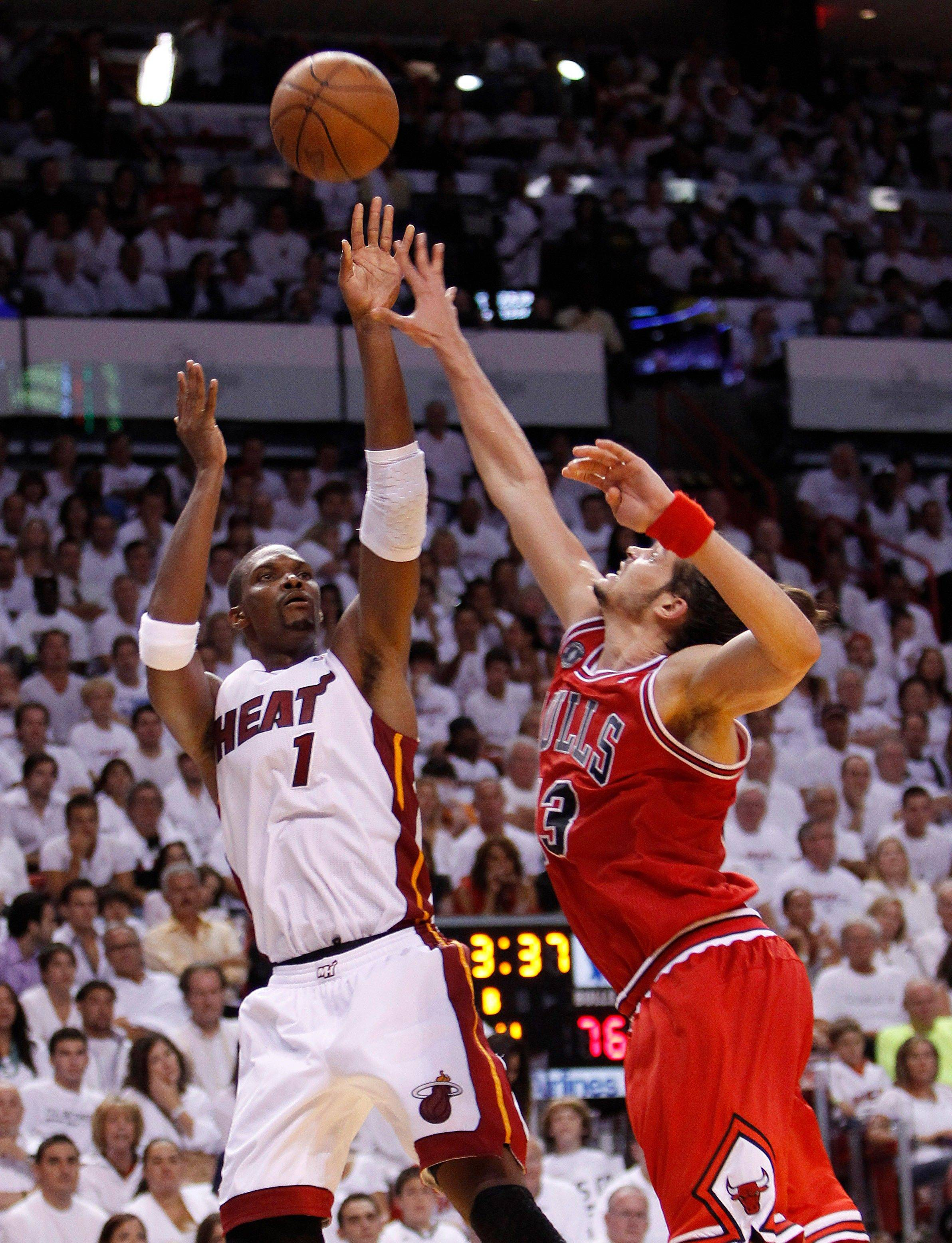 Miami Heat's Chris Bosh (1) goes up for a shot against Chicago Bulls' Joakim Noah during the second half of Game 3 of the NBA Eastern Conference finals basketball series in Miami, Sunday, May 22, 2011. The Heat defeated the Bulls 96-85.
