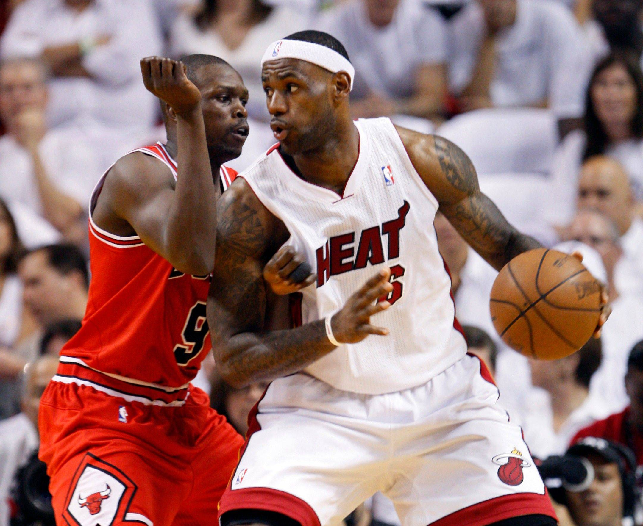 Miami Heat's LeBron James (6) backs down Chicago Bulls Luol Deng (9) during Game 3 of the NBA Eastern Conference finals basketball series in Miami, Sunday, May 22, 2011.