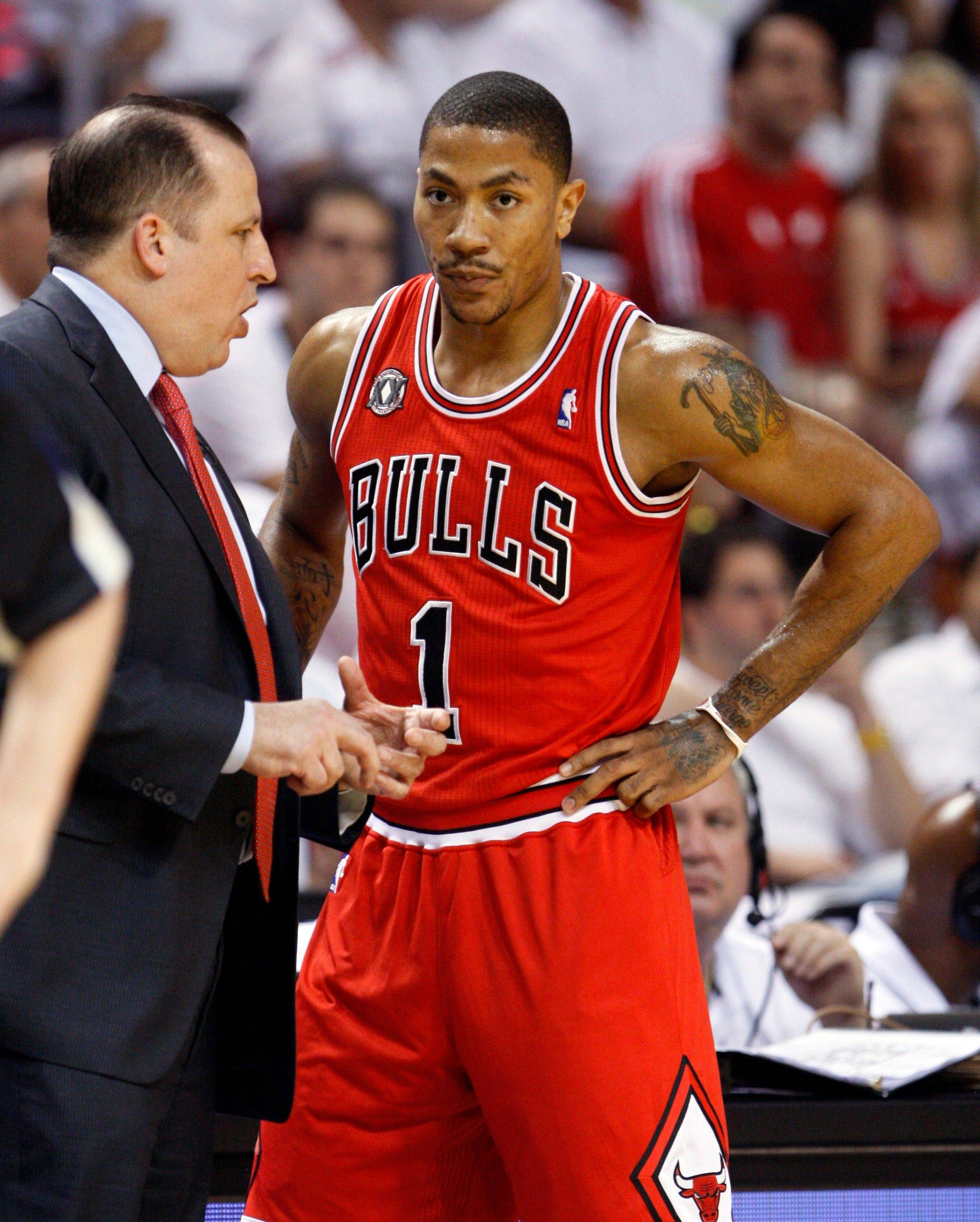 Chicago Bull's head coach Tom Thibodeau speaks to Derrick Rose during the first half of Game 3 of the NBA Eastern Conference finals basketball series against the Miami Heat in Miami, Sunday, May 22, 2011.