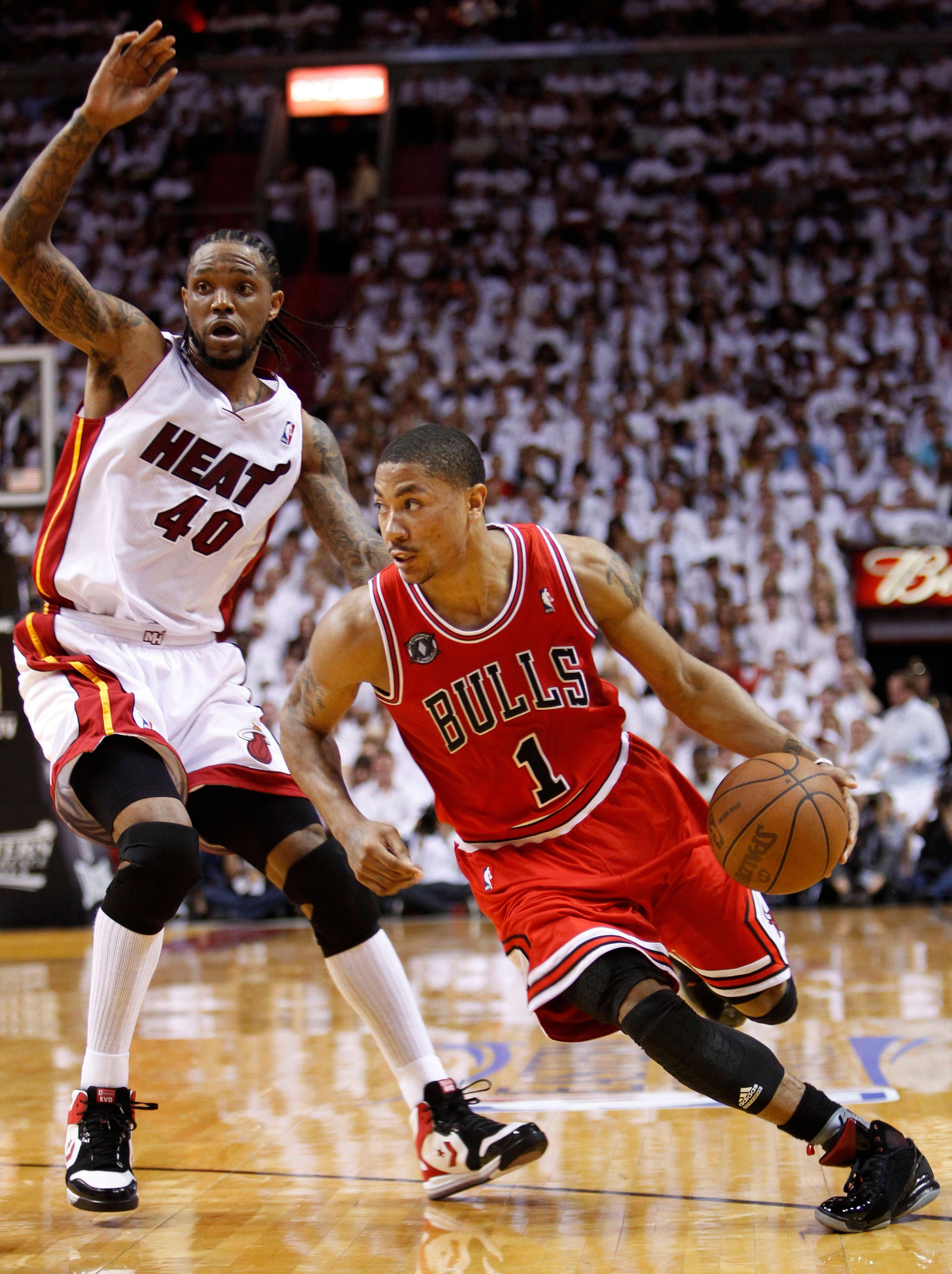 Chicago Bulls' Derrick Rose (1) drives to the basket past Miami Heat's Udonis Haslem (40) during the second half of Game 3 of the NBA Eastern Conference finals basketball series in Miami, Sunday, May 22, 2011.