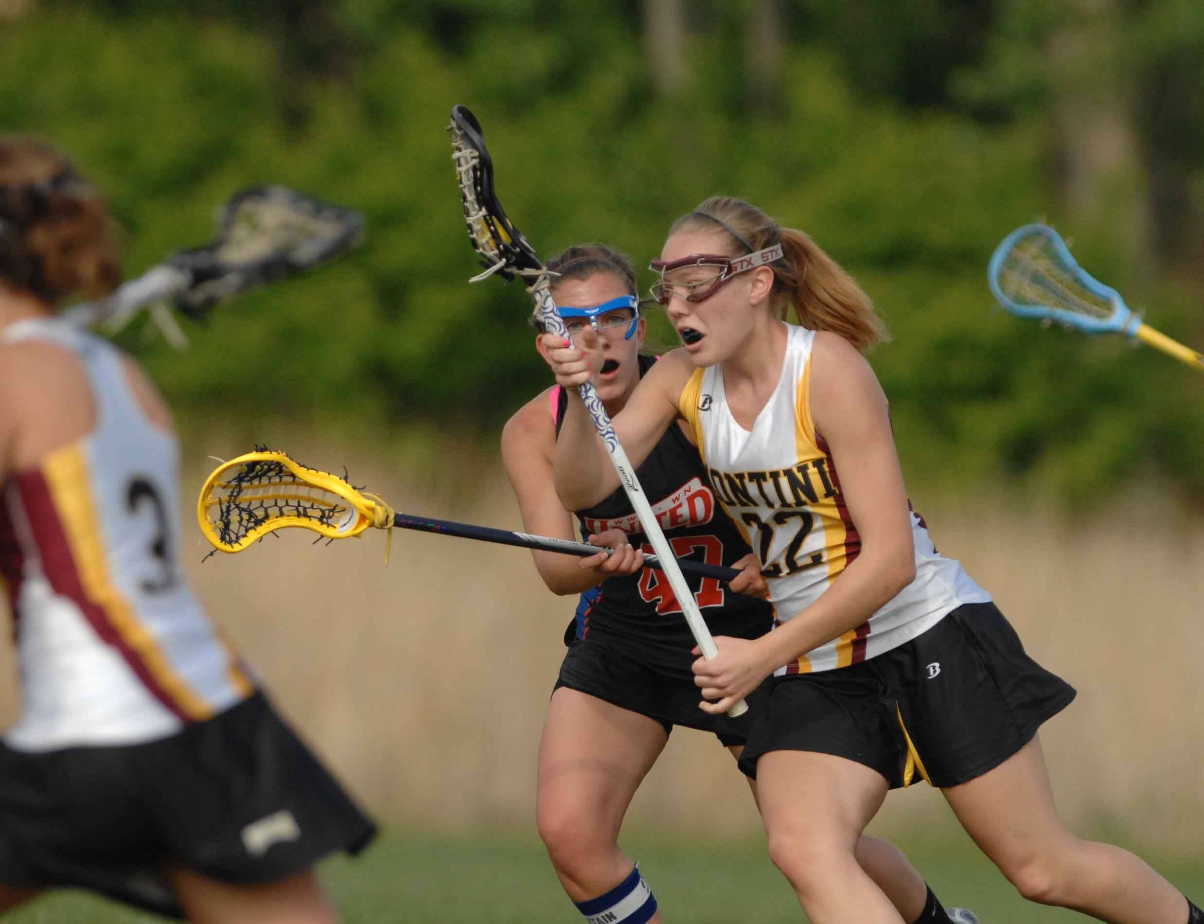Fran Meyer of Montini moves the ball during the Wheaton vs. Montini girls sectional Lacrosse in Naperville Thursday.