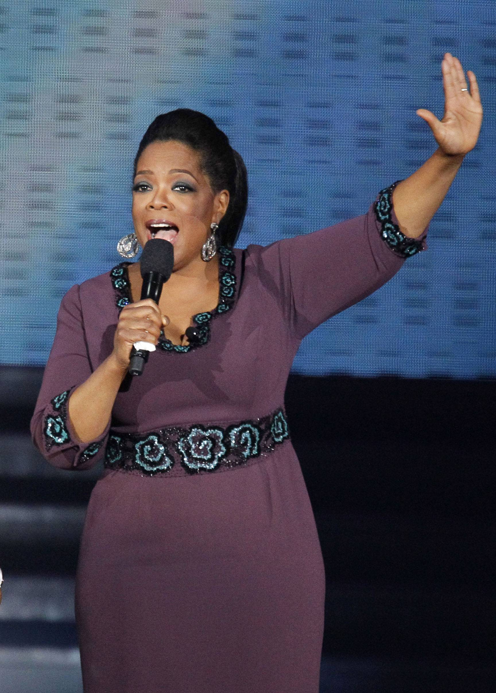 "Oprah Winfrey acknowledges fans during a star-studded double-taping of ""Surprise Oprah! A Farewell Spectacular,"" which airs Monday and Tuesday before her final show Wednesday."