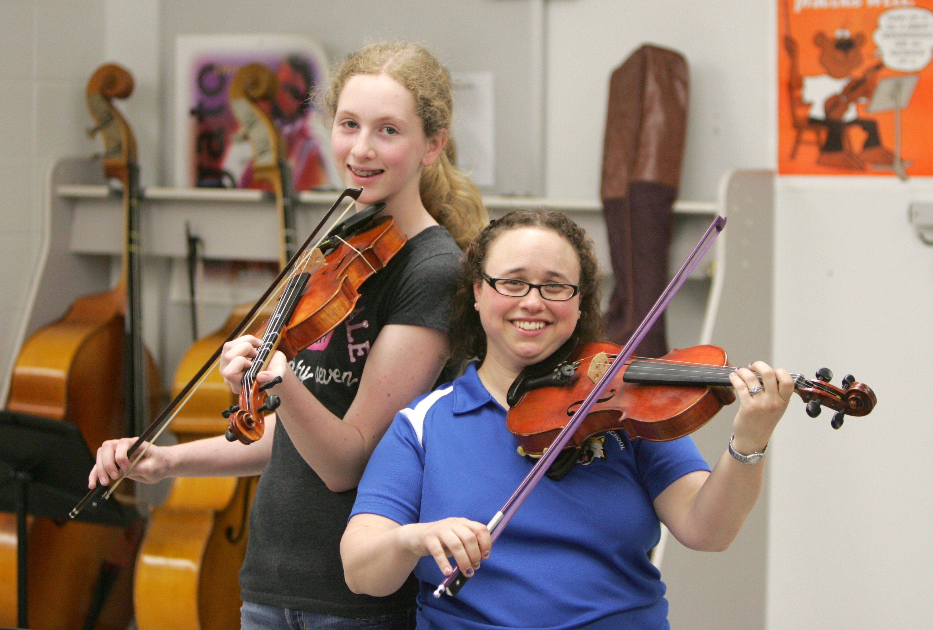 Student Melinda Boehm, left, wrote that orchestra teacher Rachel Kayser made a difference in her life.