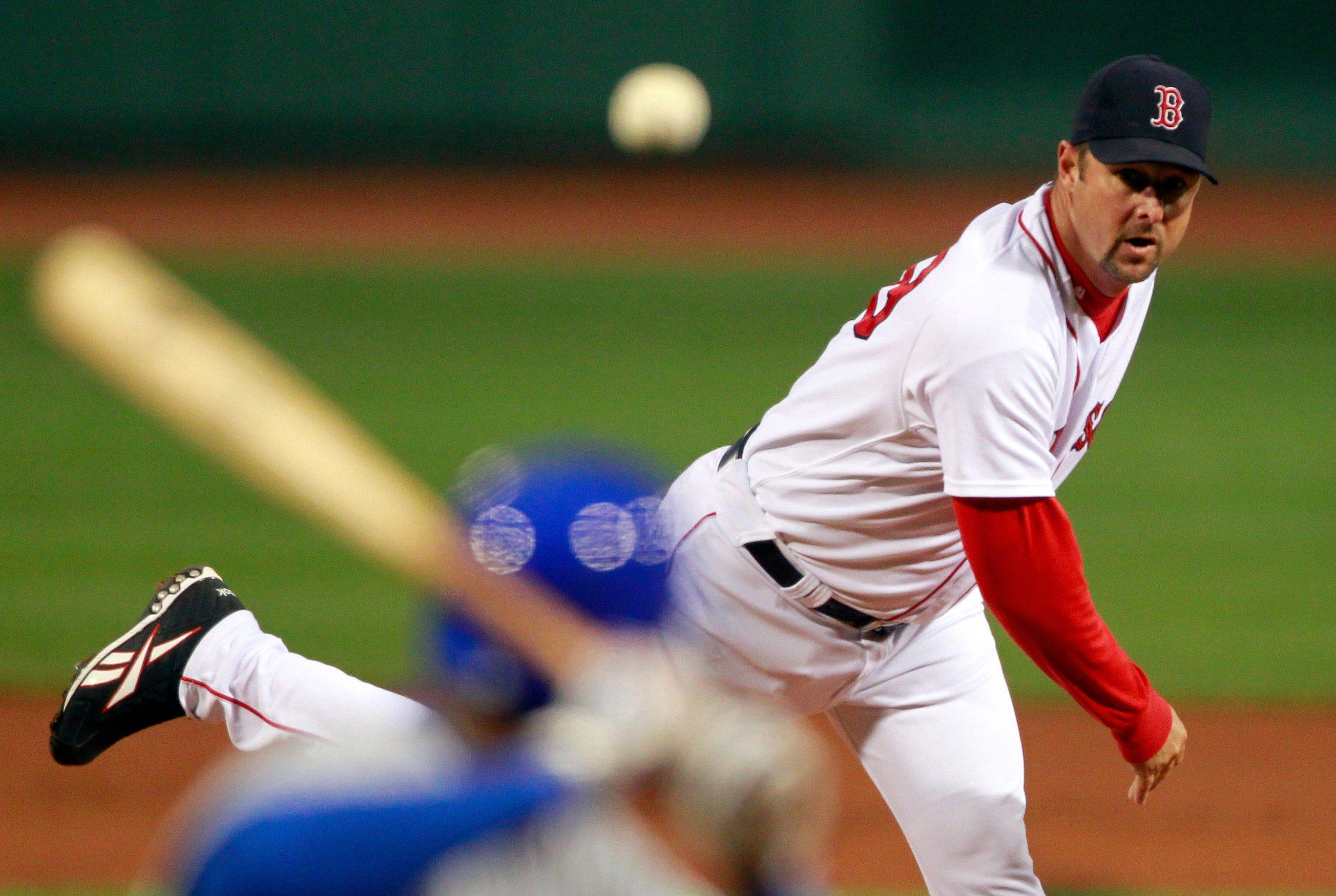Cubs batters didn't draw a single walk against Red Sox knuckleballer Tim Wakefield, above, and two relievers in Sunday night's 5-1 loss to the Red Sox.