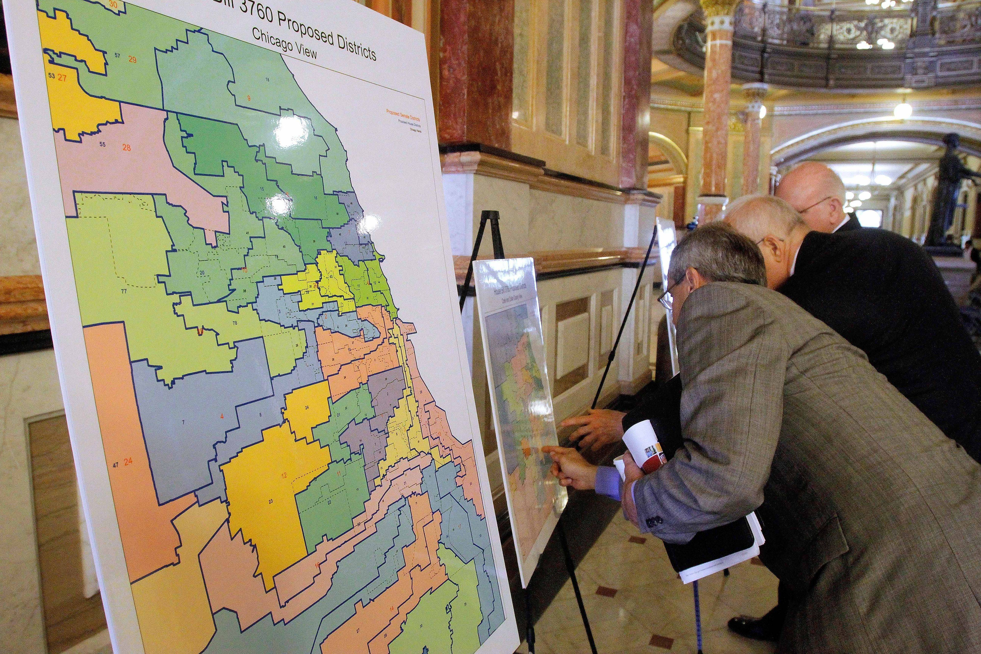 Newly proposed redistricting maps are displayed in the hallways of the Capitol in Springfield.