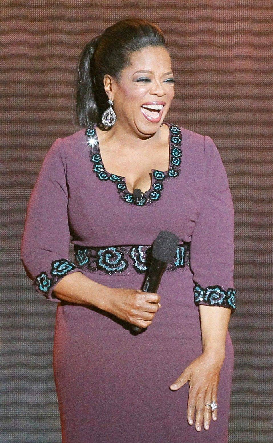 "Oprah Winfrey acknowledges fans during the taping of her ""Surprise Oprah! A Farewell Spectacular"" last week in Chicago."