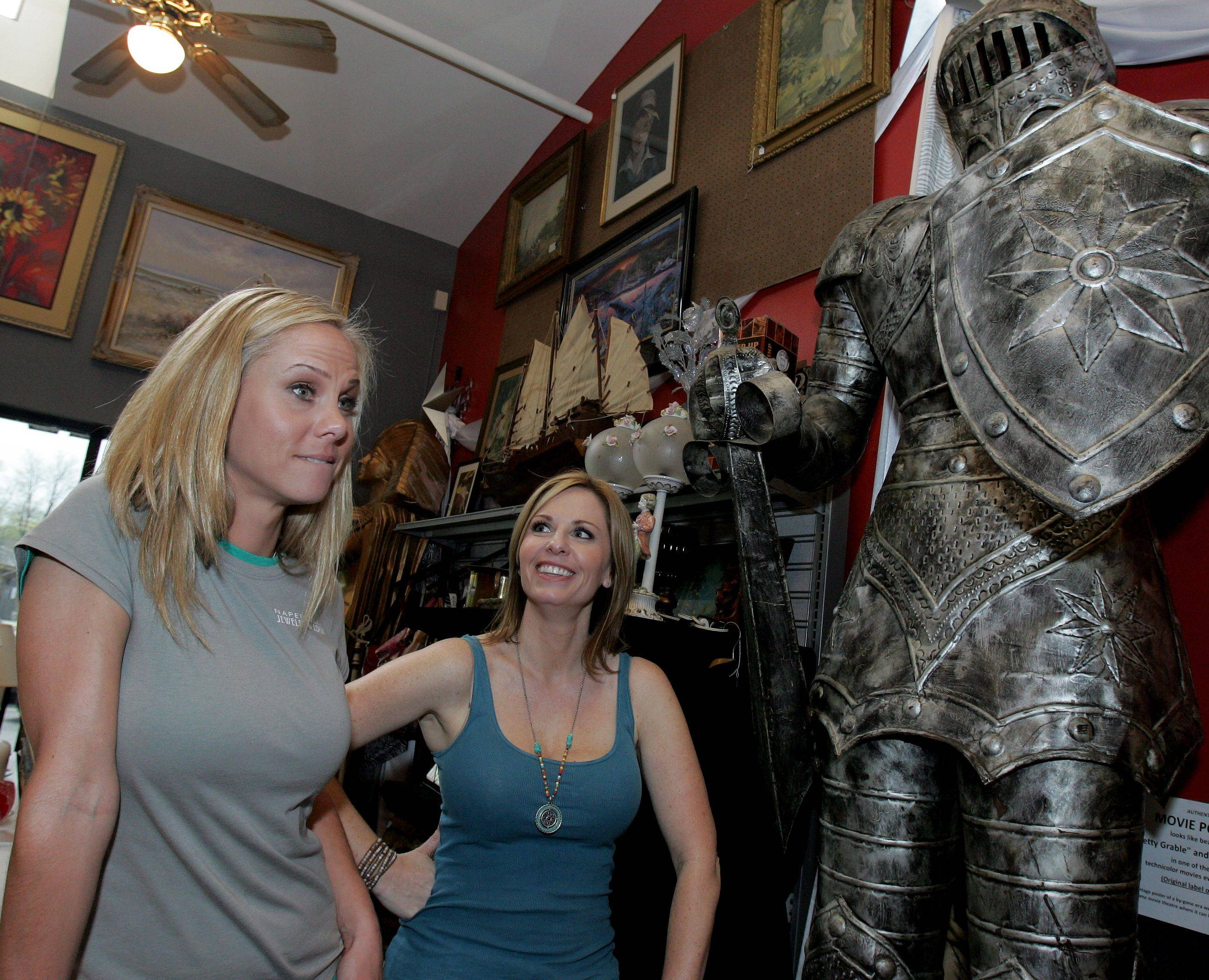 "Minda Grabiec, left, and Nikki Ruehl, co-owners of Naperville Jewelry & Loan, star in the TLC reality show ""Pawn Queens."""