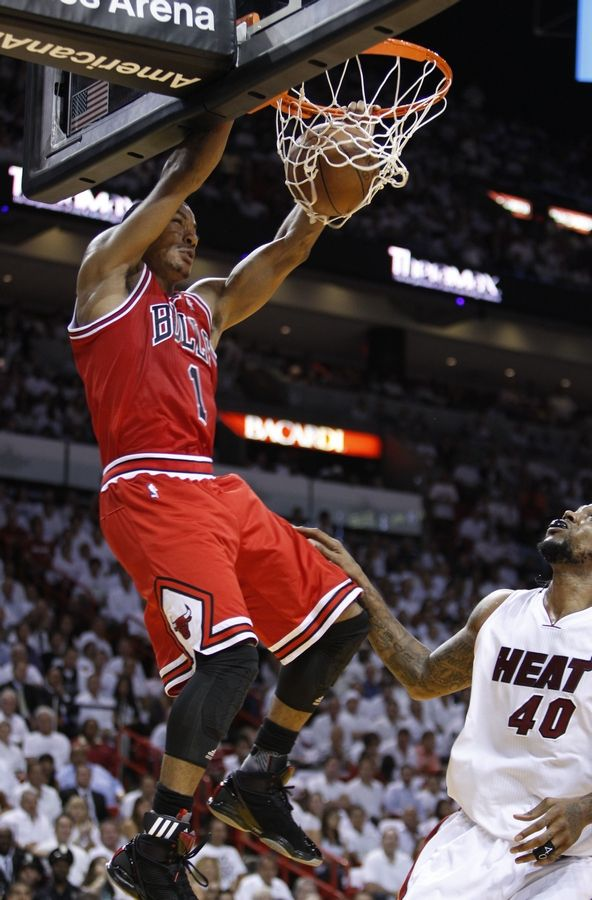 Derrick Rose dunks against Udonis Haslem uring the first half of Game 4 of the NBA Eastern Conference finals in Miami.