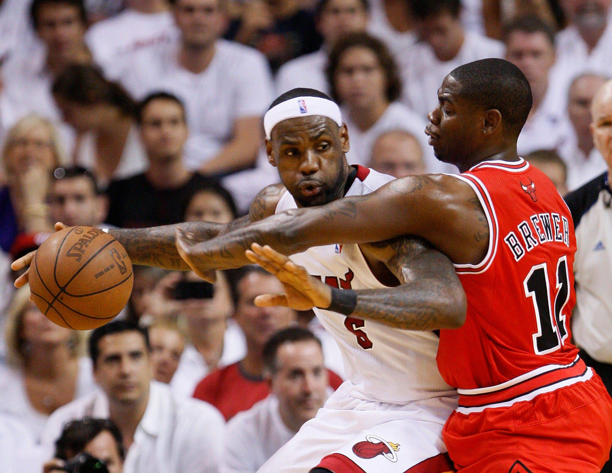 Miami Heat's LeBron James, left, drives up against Chicago Bulls' Ronnie Brewer during the first half of Game 4 of the NBA Eastern Conference finals basketball series in Miami, Tuesday, May 24, 2011.
