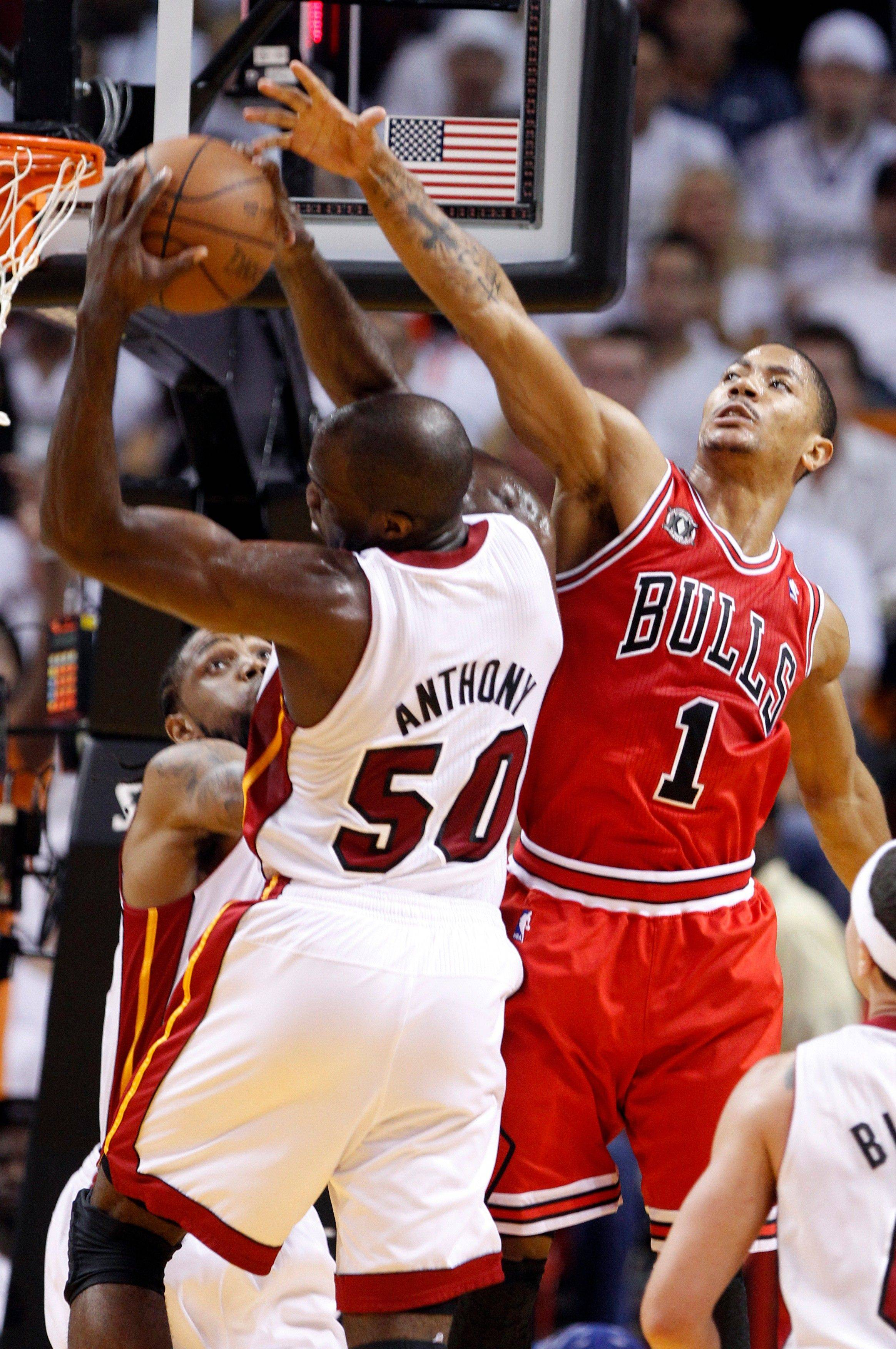 Chicago Bulls's Derrick Rose (1) defends as Miami Heat's Joel Anthony (50) grabs a rebound during the first half of Game 4 of the NBA Eastern Conference finals basketball series in Miami, Tuesday, May 24, 2011.