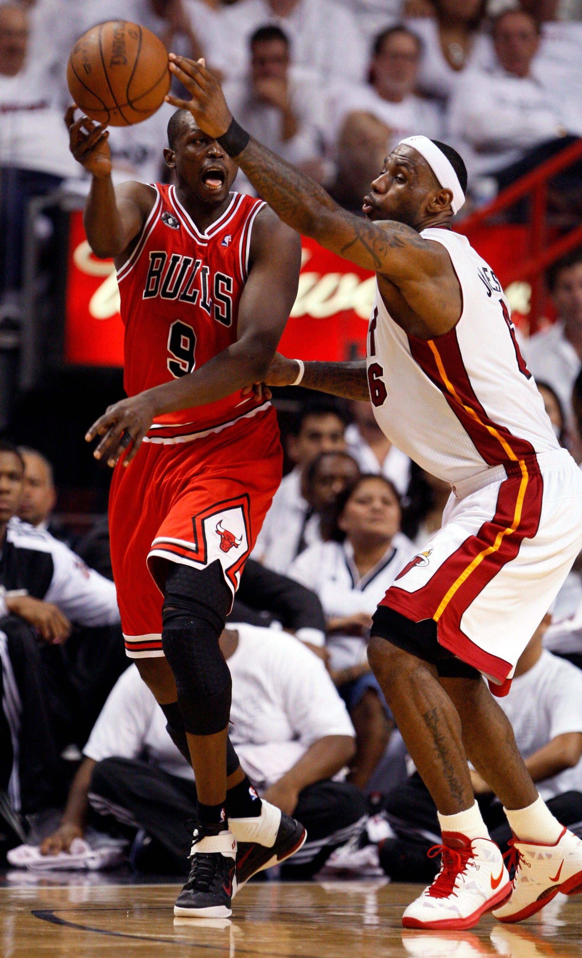 Miami Heat's LeBron James (6) blocks a pass by Chicago Bulls Luol Deng (9) during the second half of Game 4 of the NBA Eastern Conference finals basketball series in Miami, Tuesday, May 24, 2011.