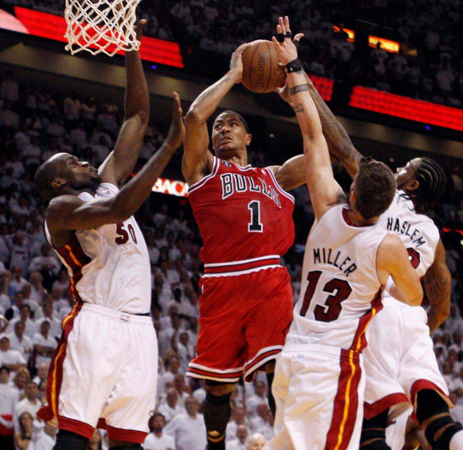 Miami Heat's Mike Miller (13), Udonis Haslem and Joel Anthony surrround Chicago Bulls' Derrick Rose (1) as he goes for a basket during the second half of Game 4 of the NBA Eastern Conference finals basketball series in Miami, Tuesday, May 24, 2011.