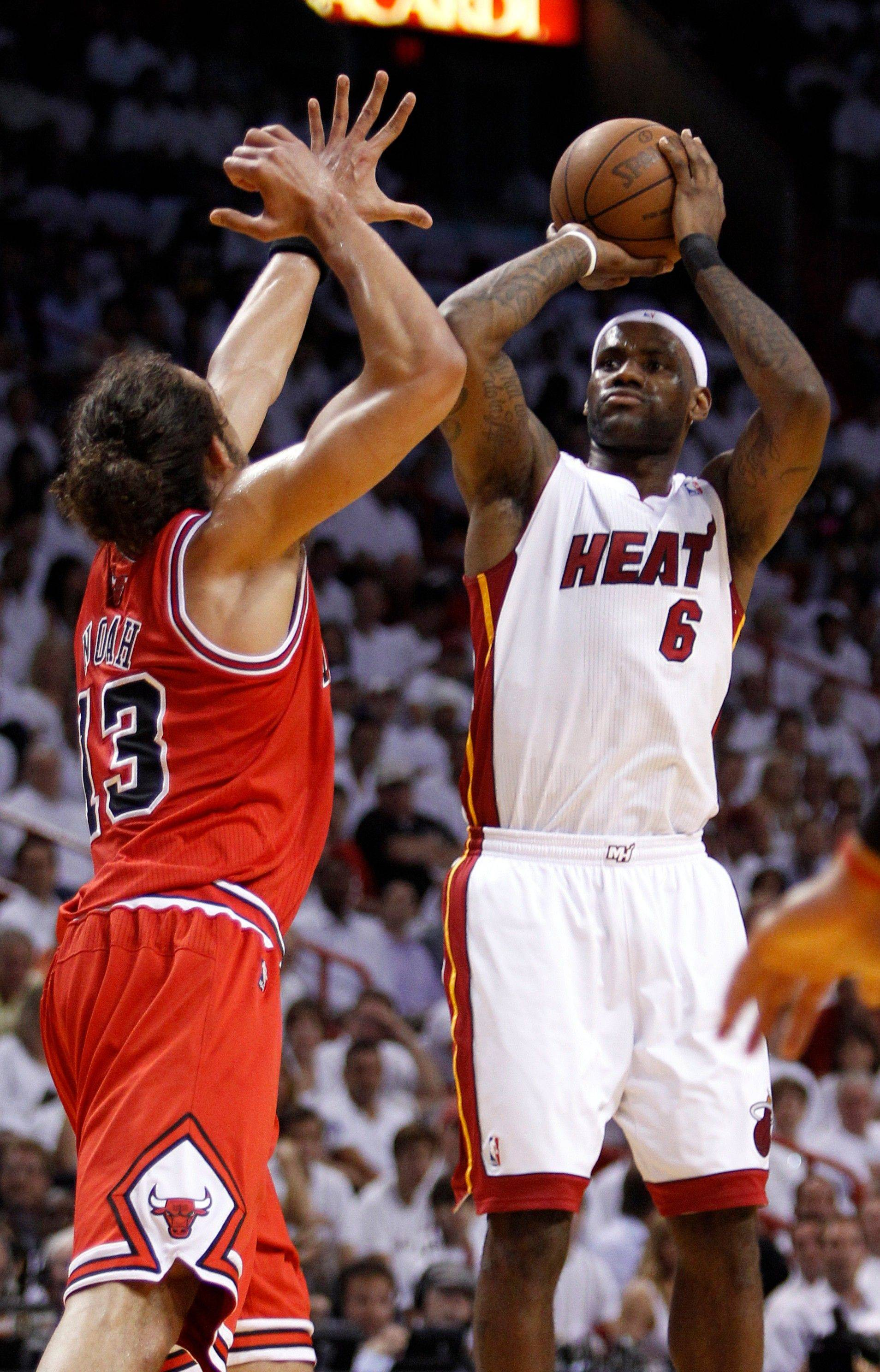 Miami Heat's LeBron James (6) goes for a basket as Chicago Bulls Joakim Noah (13) defends during the first half of Game 4 of the NBA Eastern Conference finals basketball series in Miami, Tuesday, May 24, 2011.