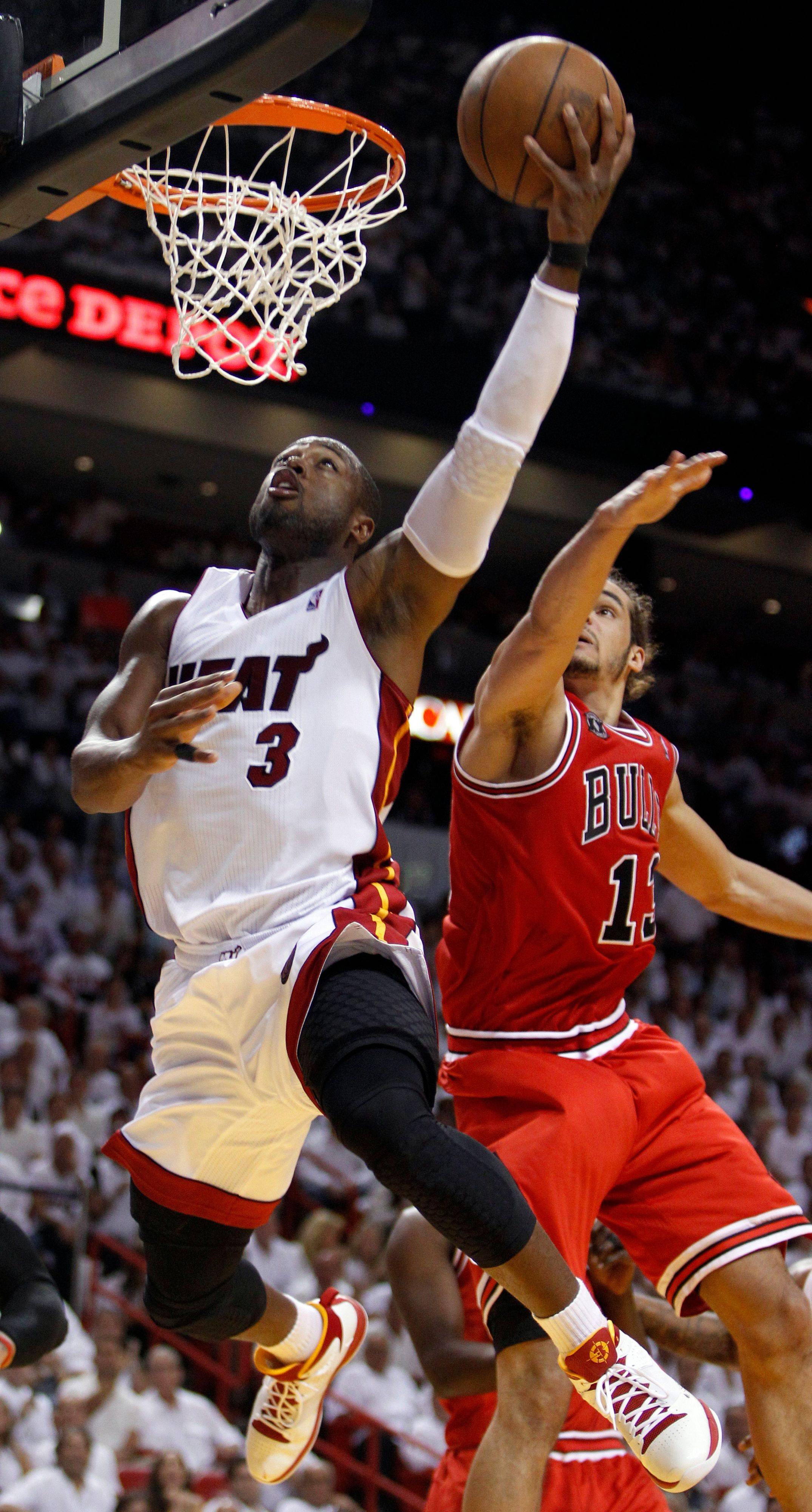 Miami Heat guard Dwyane Wade goes the Bulls' Joakim Noah for a basket during the first half of Game 4 of the NBA Eastern Conference finals Tuesday.
