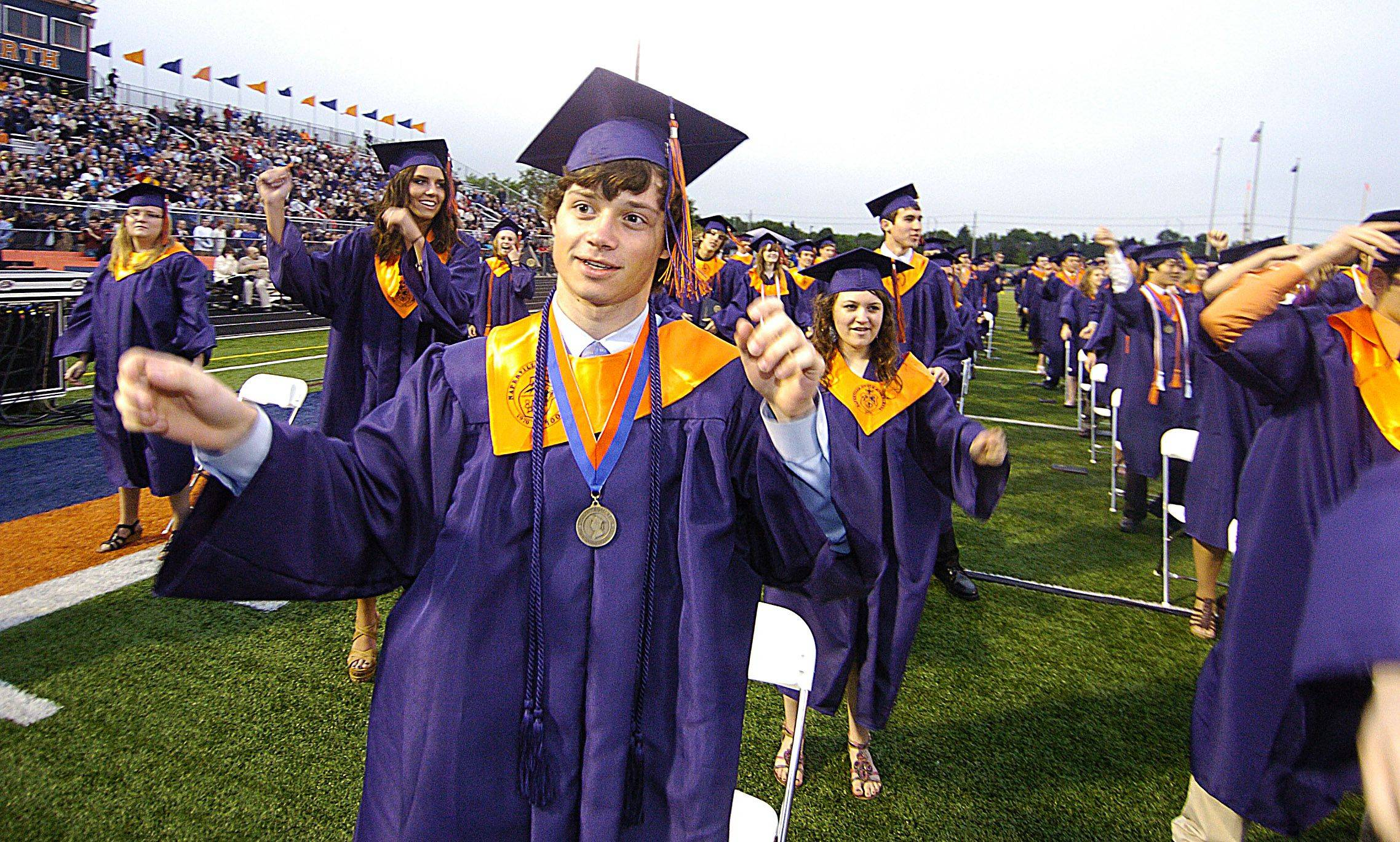 The graduating class of 2011 performs a flash mob dance to close out the Naperville North High School graduation ceremony.