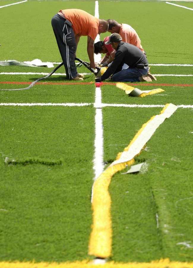 Installation of the new artificial turf at Nike Park continues in Naperville.