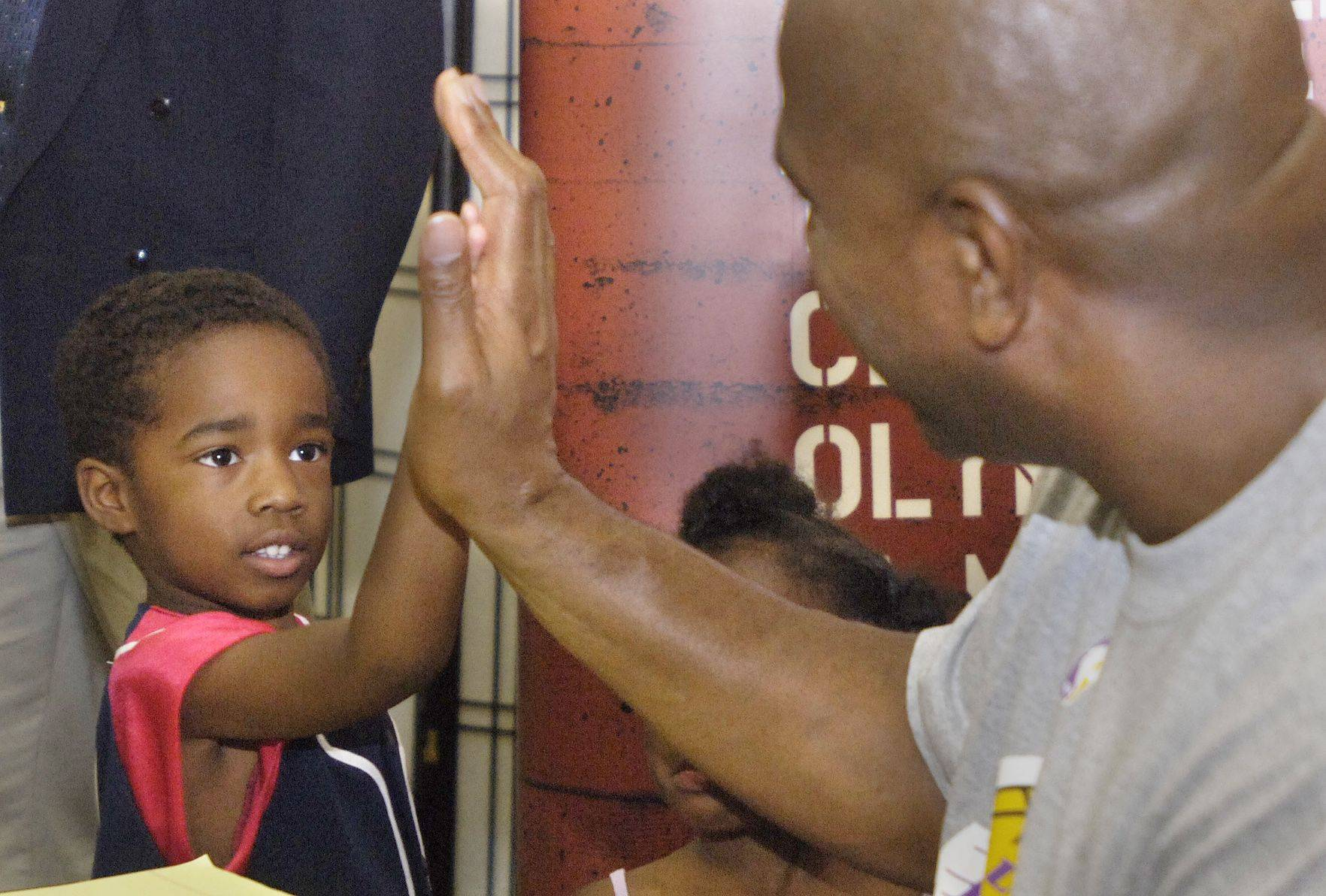 During a 2005 visit to hawk his basketball shoes at the Meijer Superstore in Elgin, NBA legend Magic Johnson makes an impression on 4-year-old Patrick Stephen. Shortly after being diagnosed with HIV, the likable superstar brought his fame and his message to The Oprah Show.