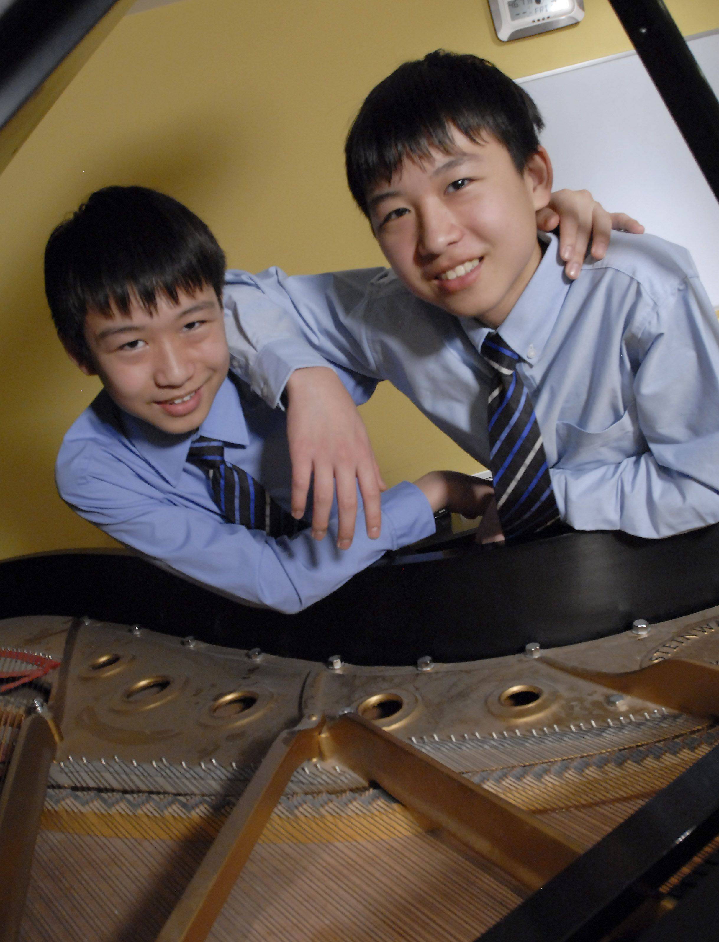 Twins Ryan, left, and Kyle Jannak-Huang of Palatine are 13-year-old classical pianists.