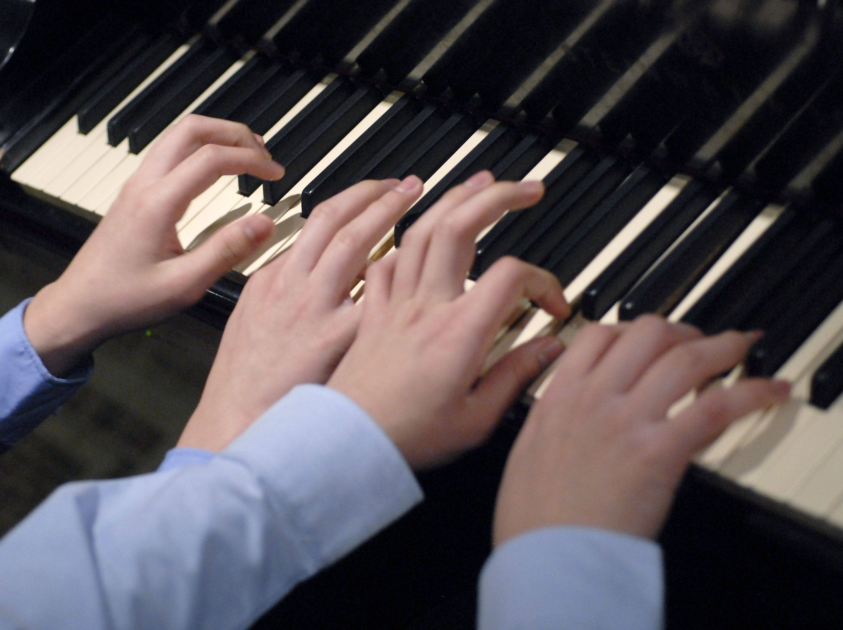 Twins Kyle and Ryan Jannak-Huang of Palatine are 13-year-old classical pianists.