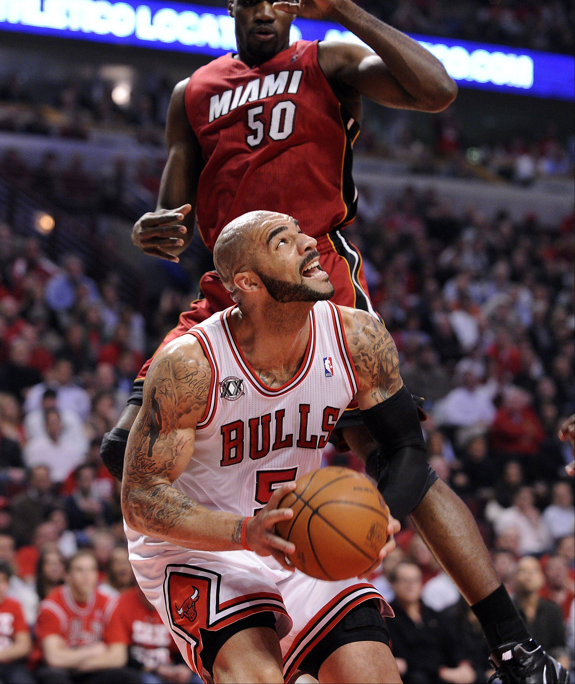 Carlos Boozer eyes the basket as the Heat's Joel Anthony attemps to block in the first half.