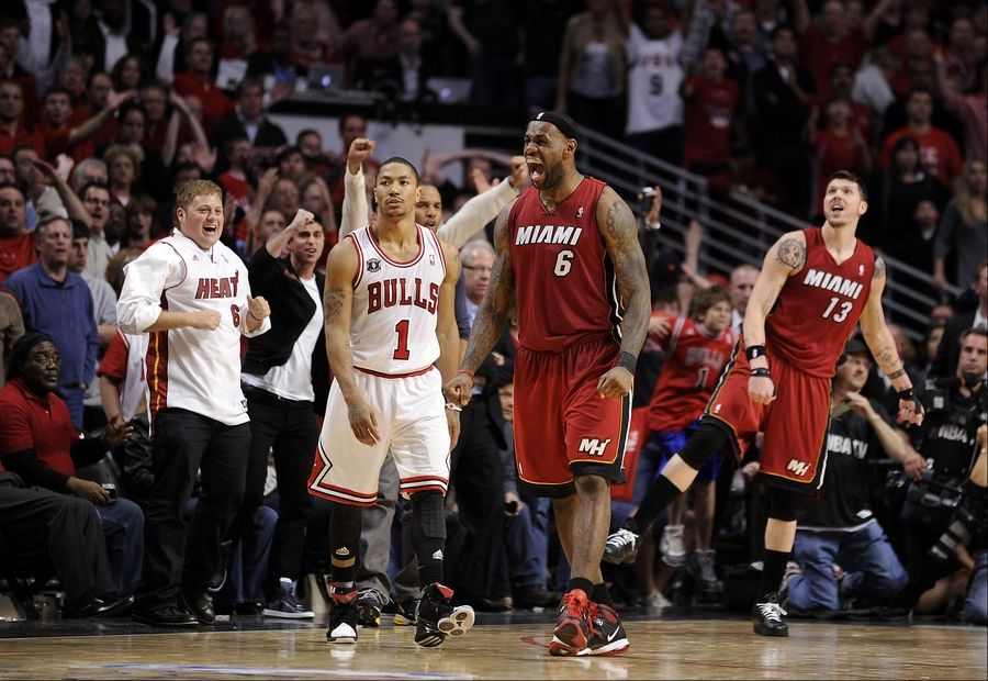 The Heat's LeBron James celebrates his victory as Bulls' Derrick Rose walks away with a stunned look on his face after the Heat ended the dreams ot the Bulls making the finals at the United Center on Thursday.