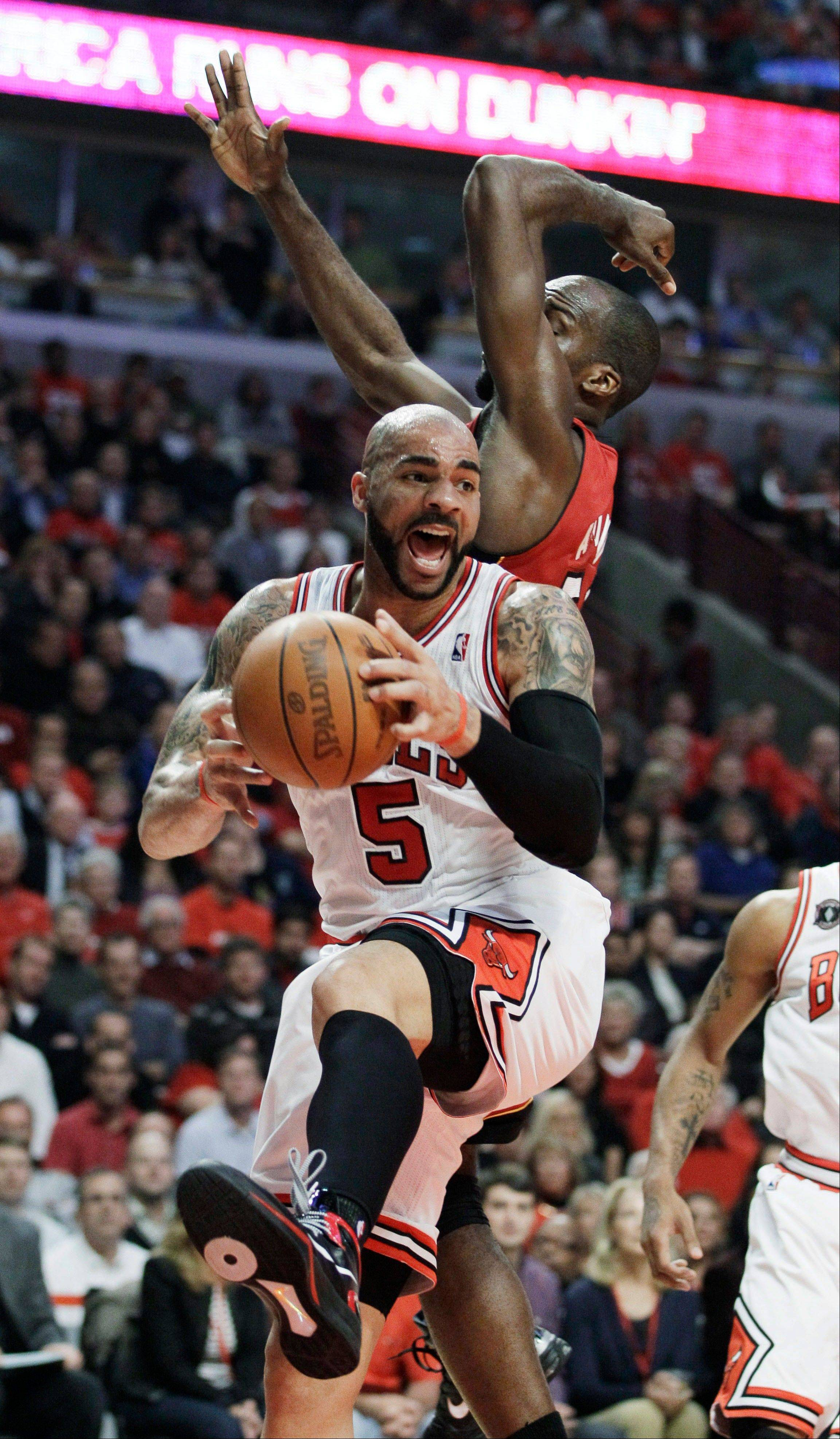 Carlos Boozer grabs a rebound against Miami Heat center Joel Anthony during the first quarter of Game 5 of the Eastern Conference finals Thursday.