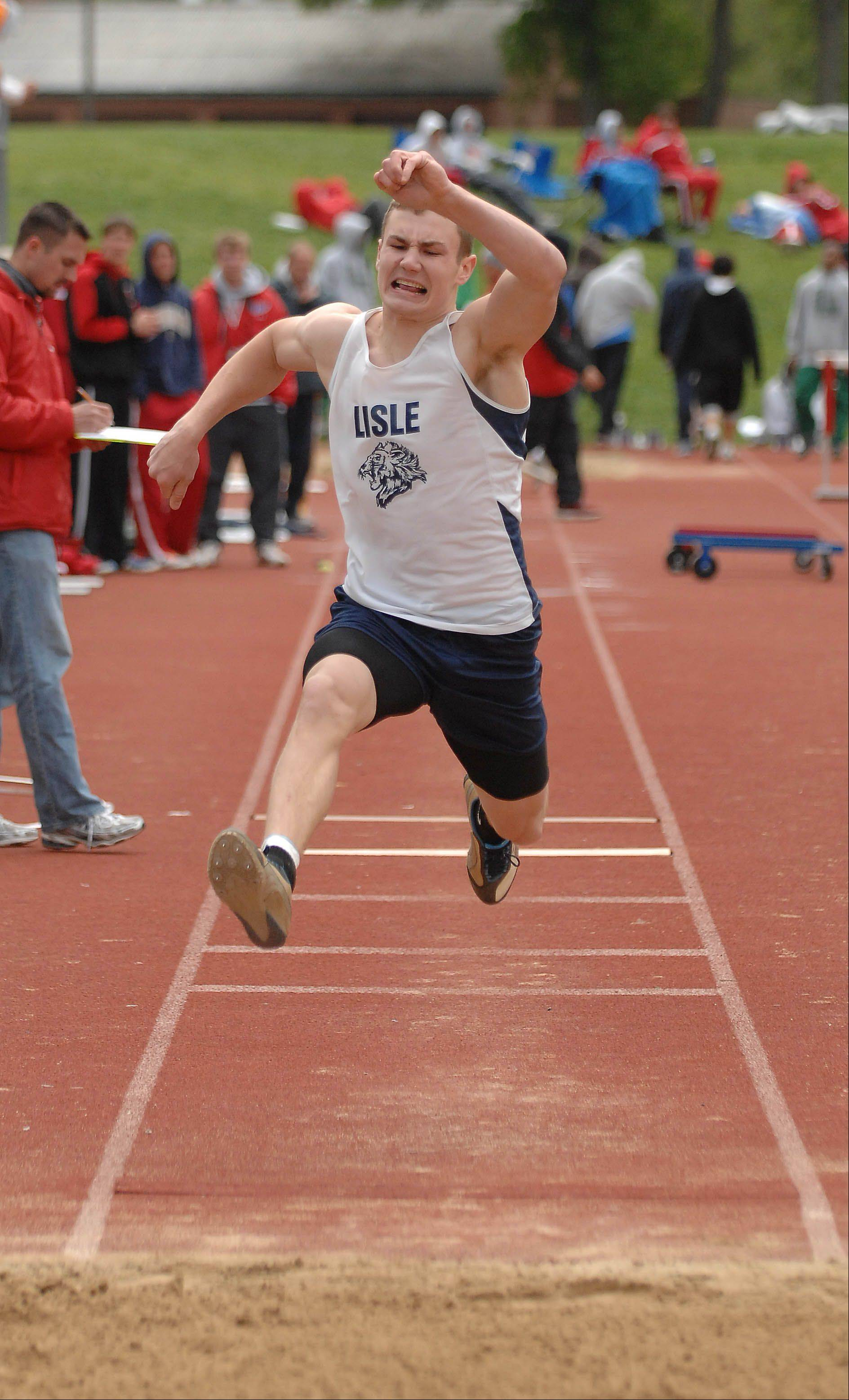PAUL MICHNA/PMICHNA@DAILYHERALD.COM � Anthony Ventrella of lisle in the triple jump during the Carlin Nalley Track & Field Invitational Saturday at Benedictine University in Lisle. �