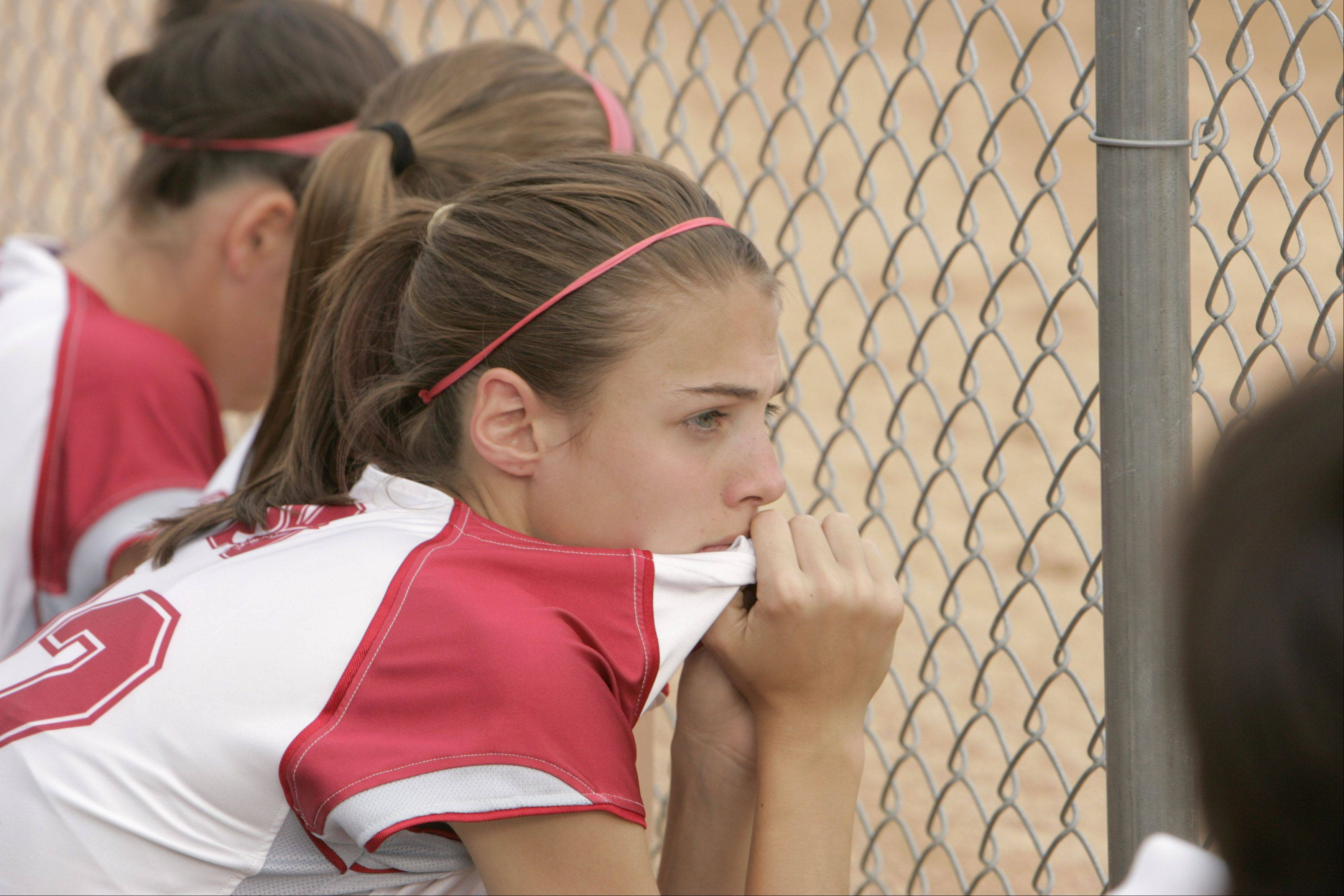 Naperville Central freshman Kristina Vizza watches her team during the final inning in their 2-0 loss to Edwardsville at their Class 4A semi-final game on Friday evening at the Eastside Centre fields in East Peoria.