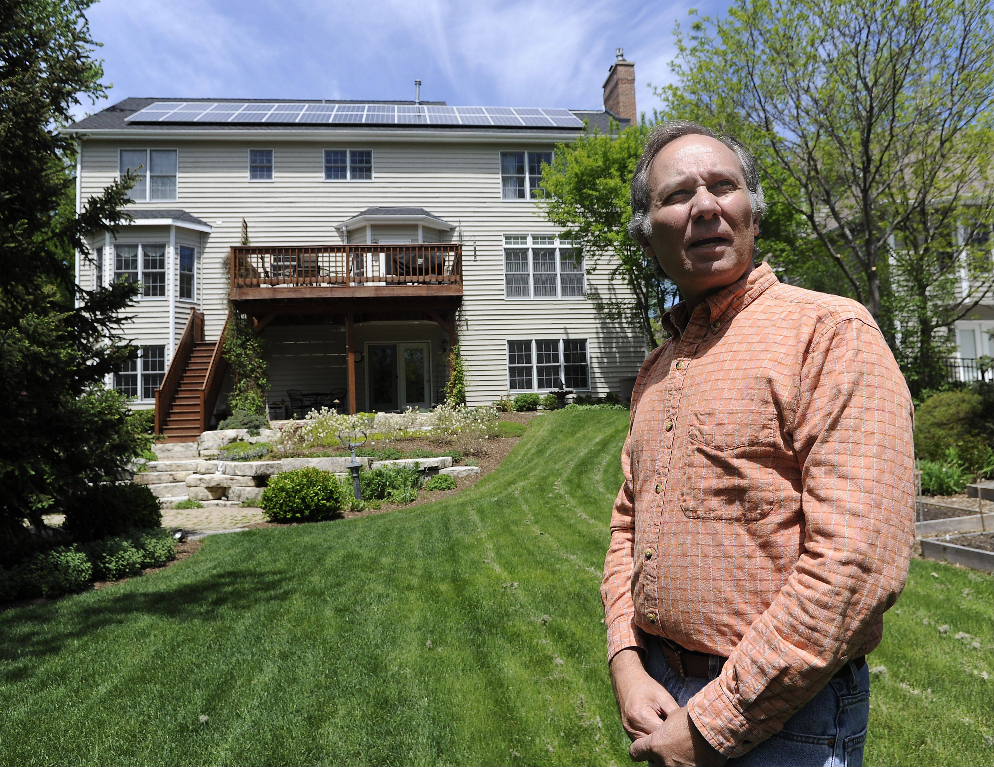 Palatine resident Peter Gorr is going green with his new solar powered system on his roof consisting of 28 panels that will cuts his energy costs.