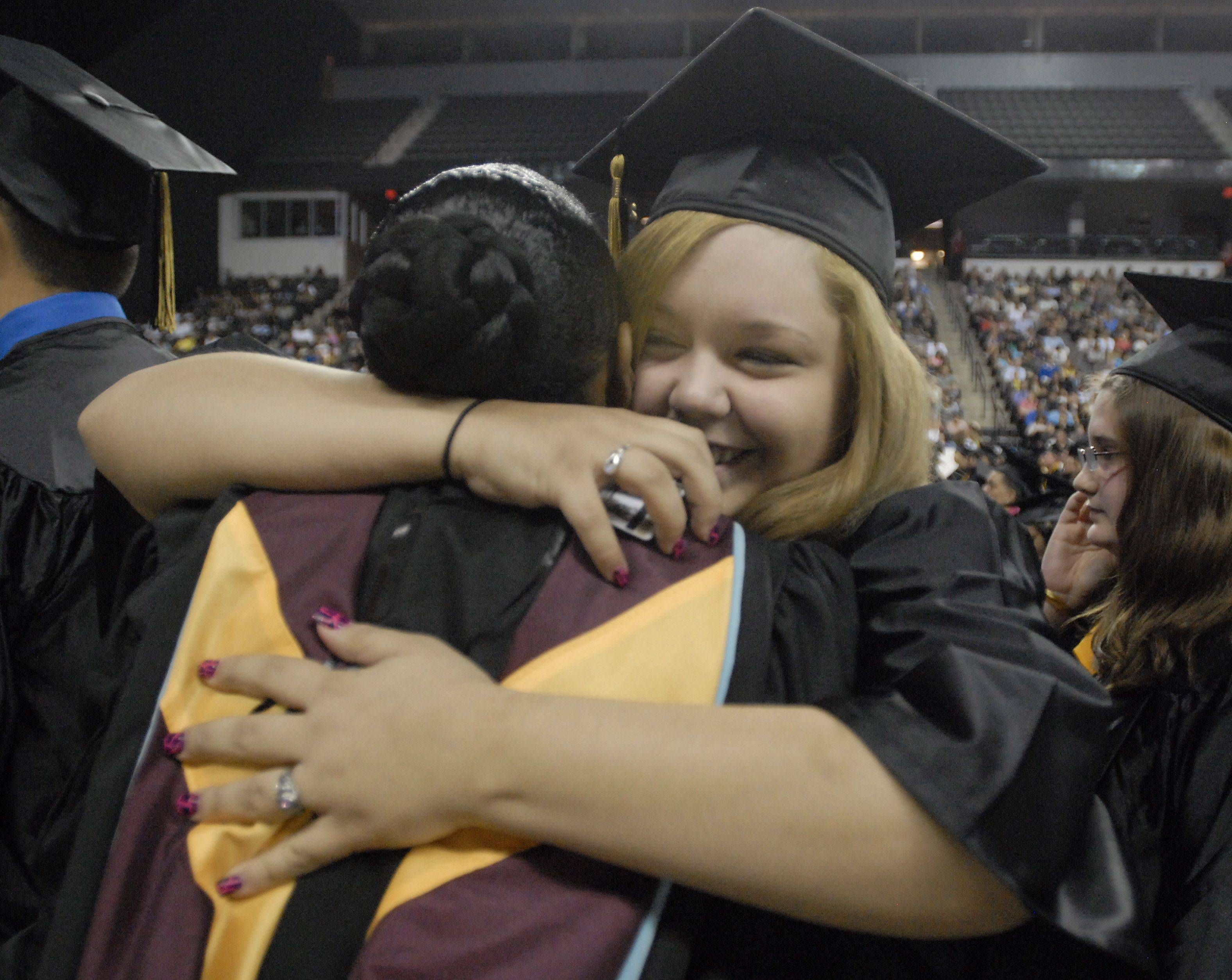 Graduate Kaitlyn Kaczynski gets a hug from ISI Coordinator Lisa Miller at the Streamwood High School graduation on May 28th at the Sears Centre.