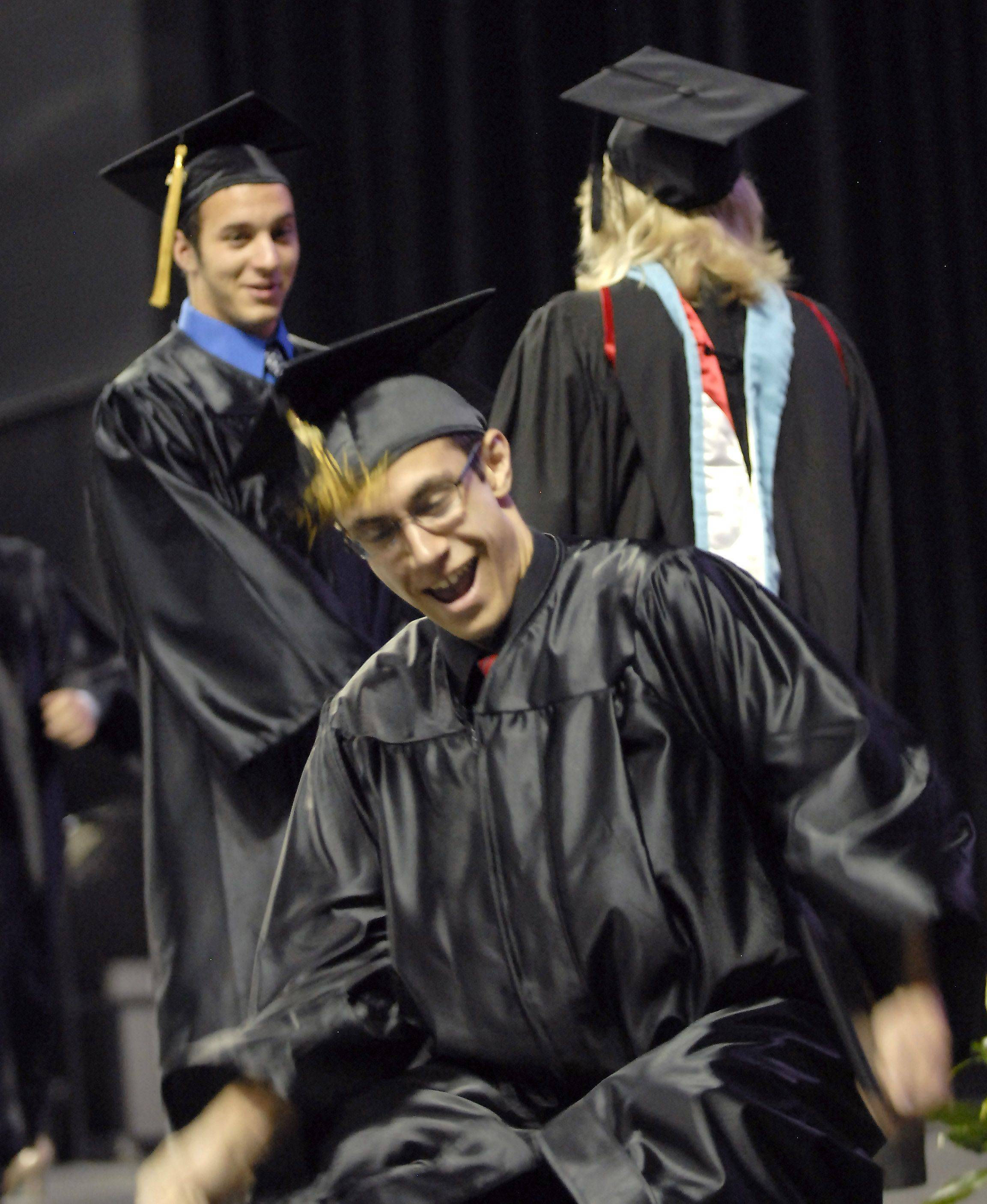 Josh Bennici gets down and dances a bit after receiving his diploma at the Streamwood High School graduation on May 28th at the Sears Centre.