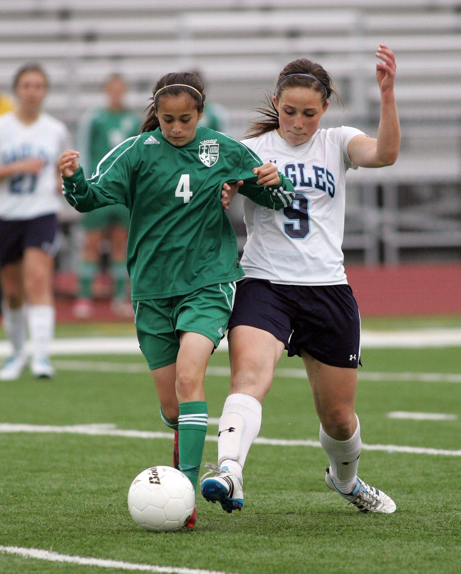 Monica Ramirez, left of St. Edward and Kate Dunaway, right, of Willows Academy in Class 1A state soccer third place match in Naperville on Saturday.