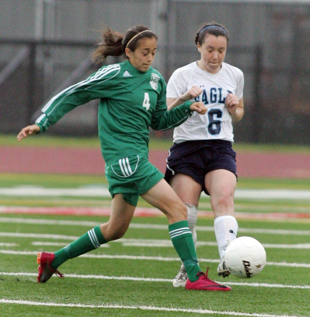 Monica Ramirez, left of St. Edward and Megan Brinckerhoff, right, of Willows Academy in the Class 1A state soccer third place match in Naperville on Saturday.