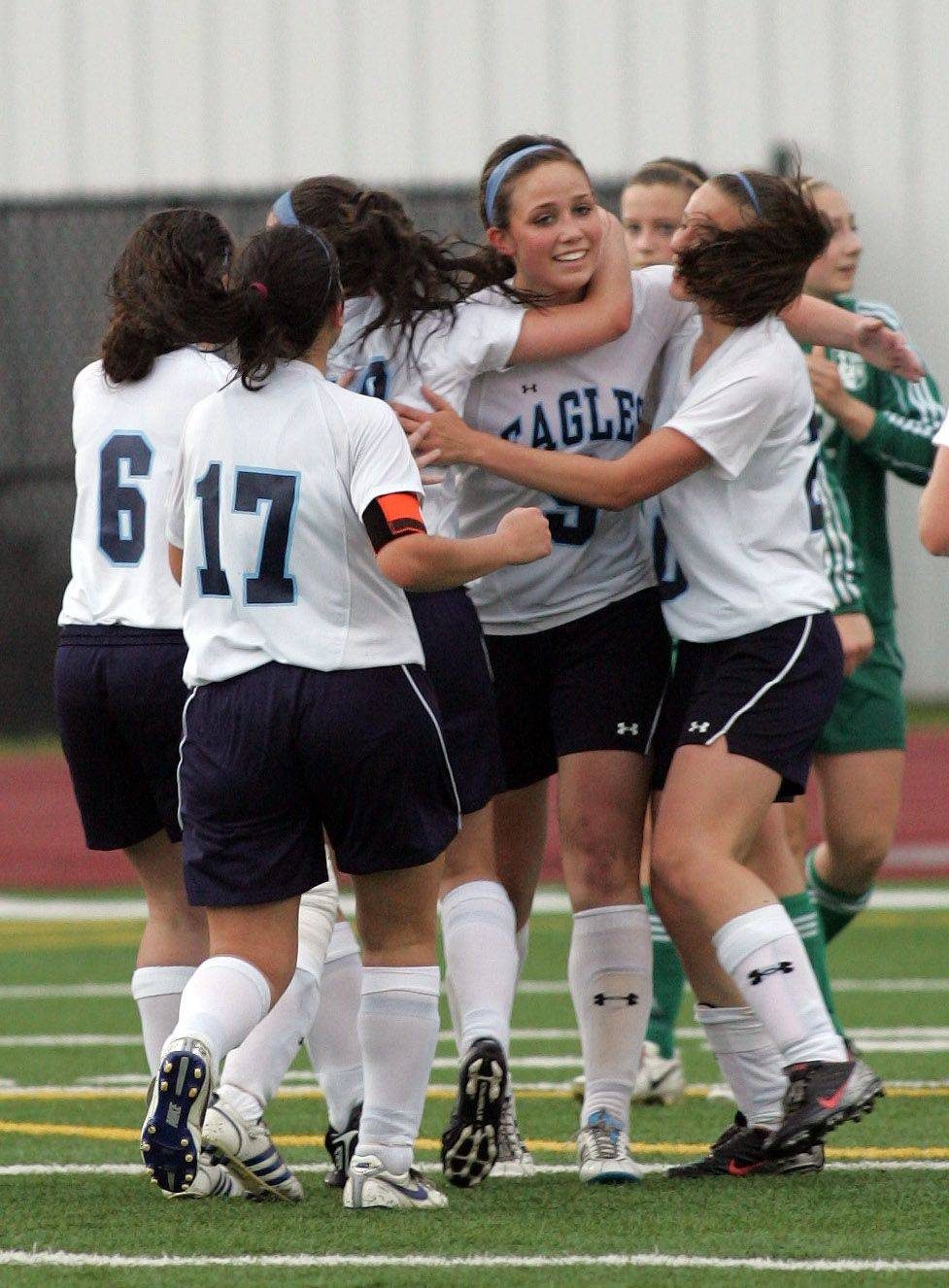 Teammates celebrate the first-half goal of Kate Dunaway, center, of Willows Academy in the Class 1A state soccer third place match in Naperville on Saturday. Willows Academy beat St. Edward 2-0.
