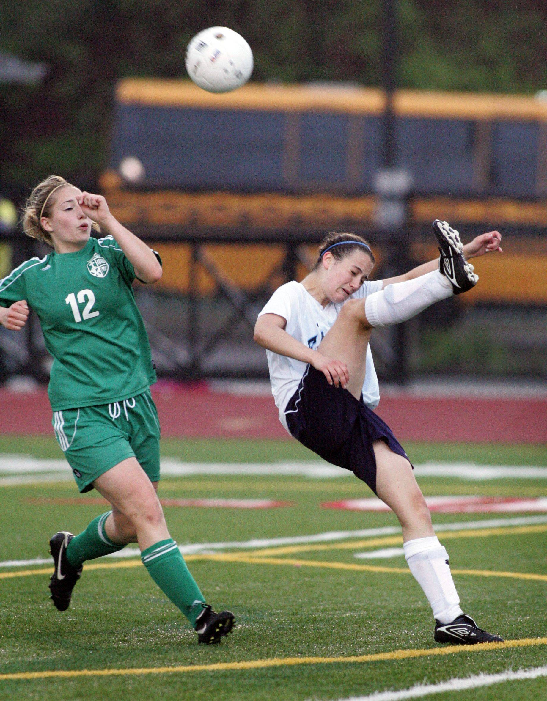 Vincenza Ranallo of St. Edward, left, moves in as Keelin McNally of Willows Academy kicks the ball back during Class 1A state soccer third place match in Naperville on Saturday.