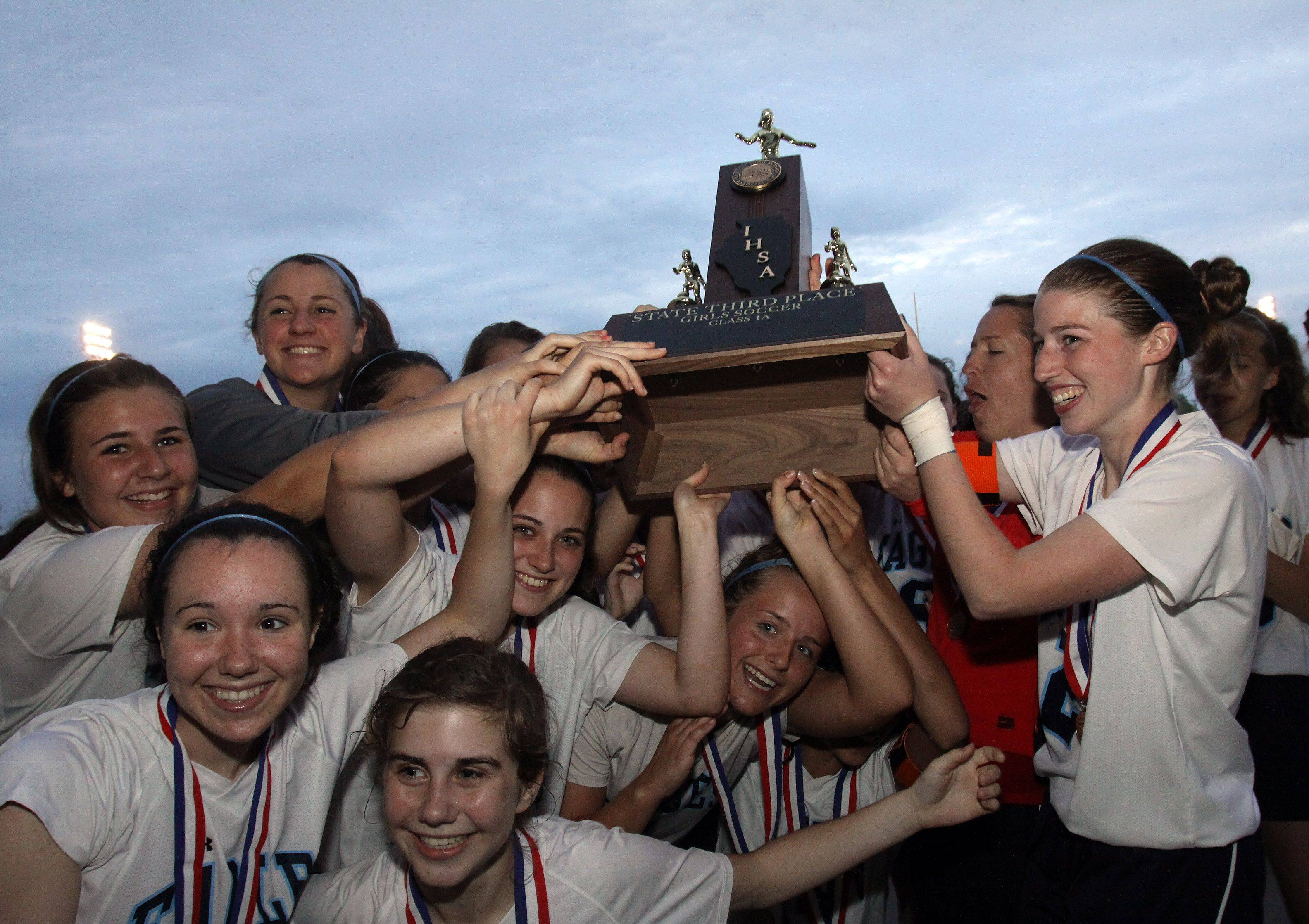 Willows Academy pose with their third place trophy for Class 1A state soccer in Naperville on Saturday.