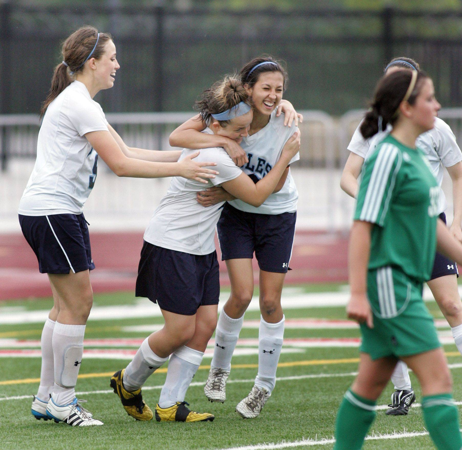Willows Academy celebrate a goal over St. Edward in the Class 1A state soccer third place match in Naperville on Saturday.