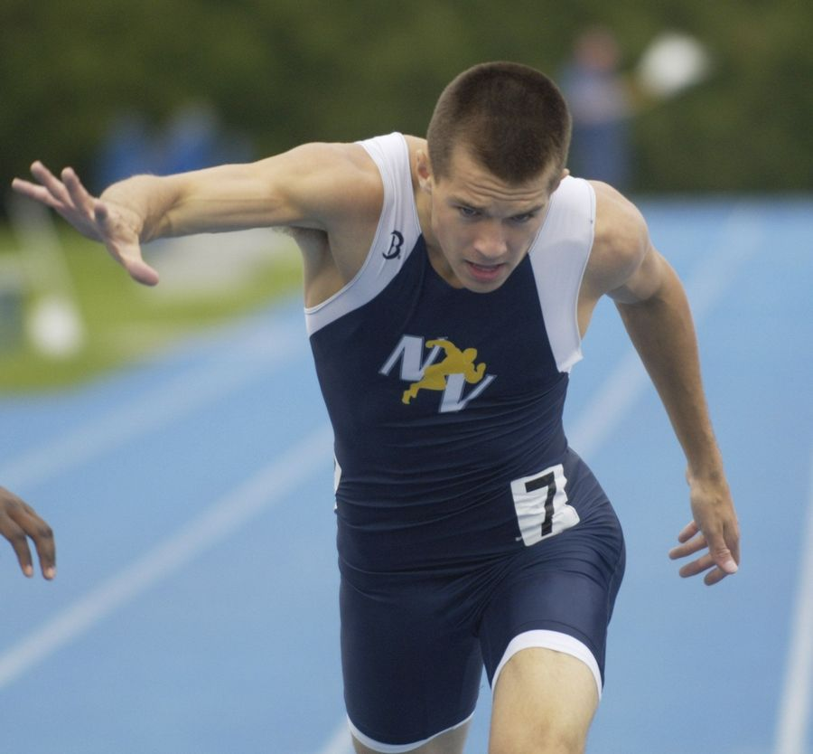 Neuqua Valley's Jacob Bender lunges toward the finish line in the class 3A 400-meter dash during the boys state track finals in Charleston Friday.
