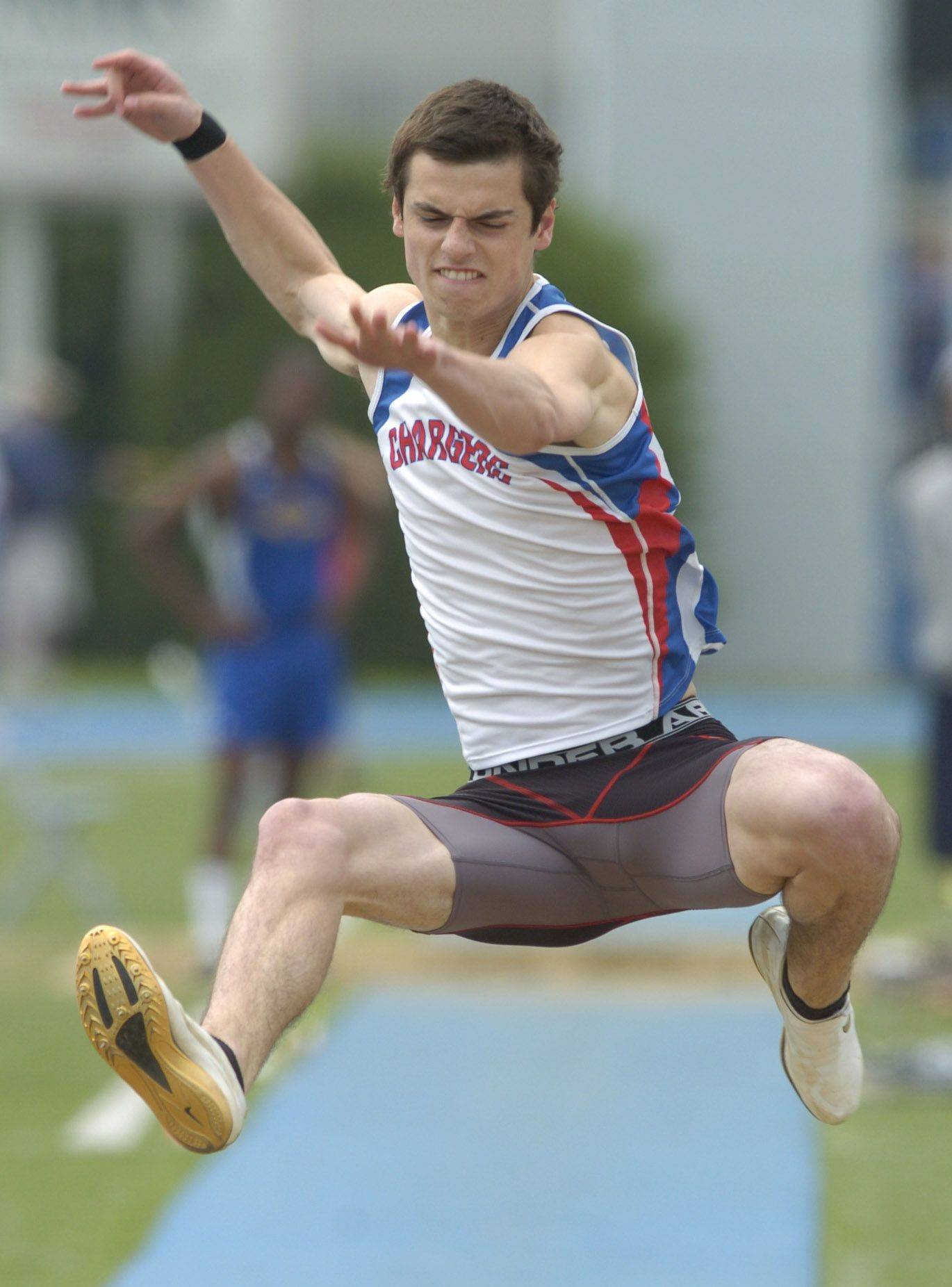Dundee-Crown's Ardian Asani comptes in the long jump during the boys state track finals in Charleston Saturday.