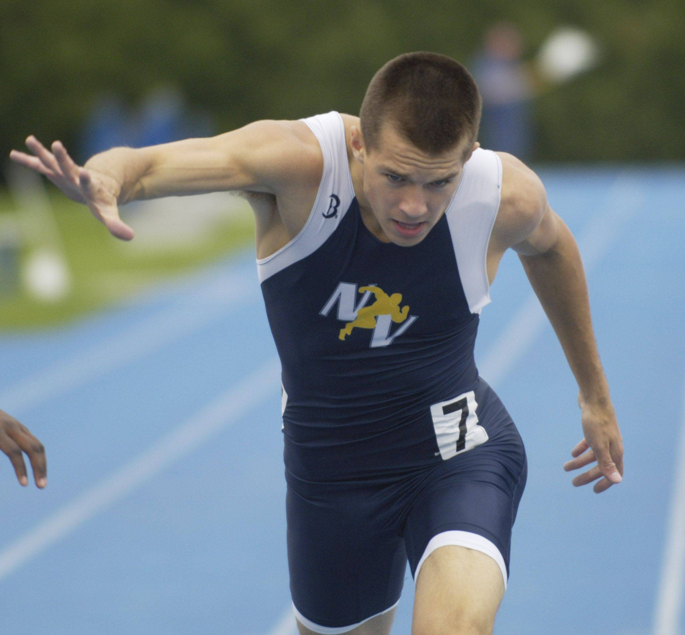 Neuqua Valley's Jacob Bender lunges toward the finish line in the class 3A 400-meter dash during the boys state track finals in Charleston Saturday.