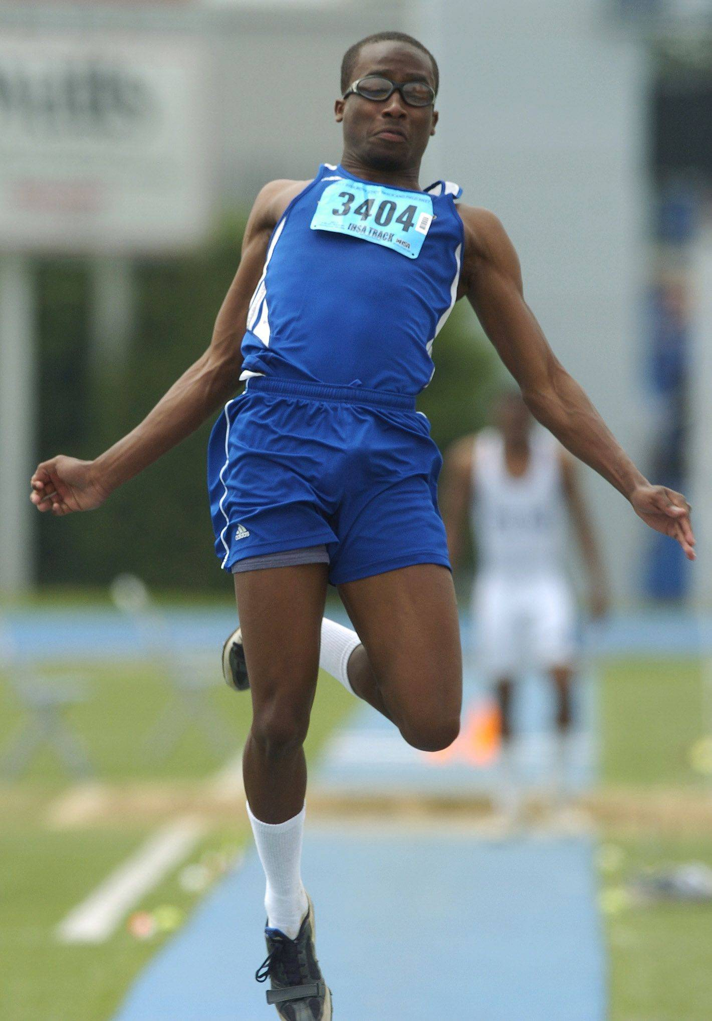 Warren's Isaac Jean-Paul competes in the long jump during the boys state track finals in Charleston Saturday.
